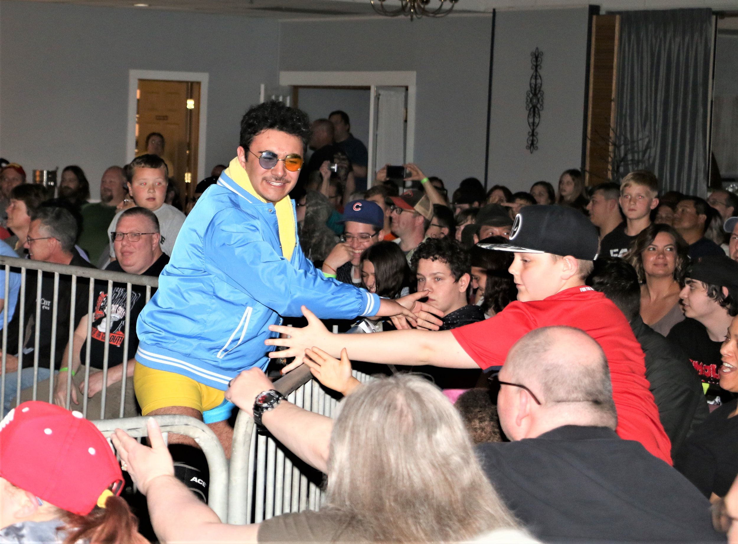 Kal Herro greets fans around the ring.