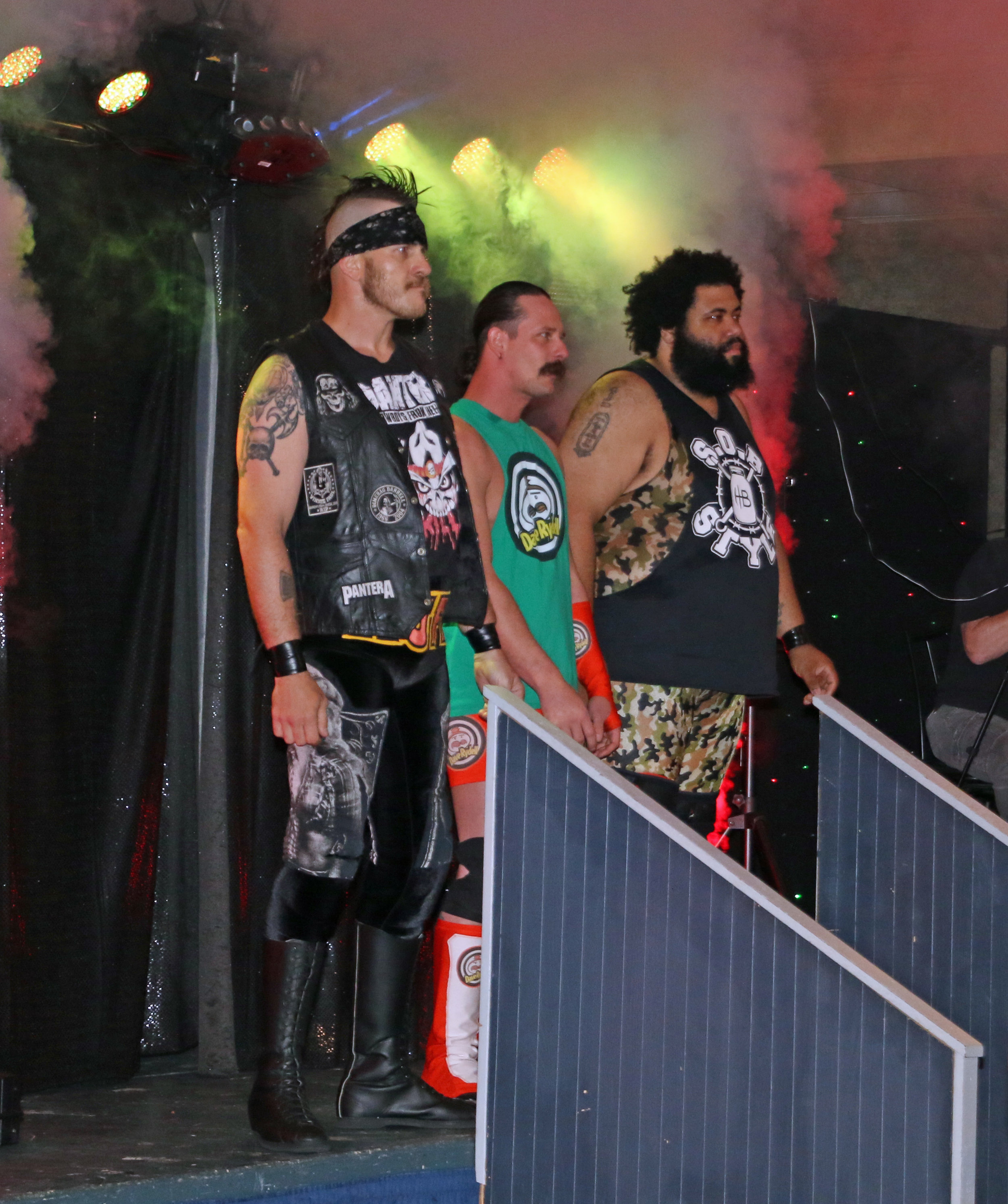 Ruff Crossing, from left, Dave Rydell and Backwoods Brown enter the arena to confront Sidney Bakabella and the Princes of the Universe.