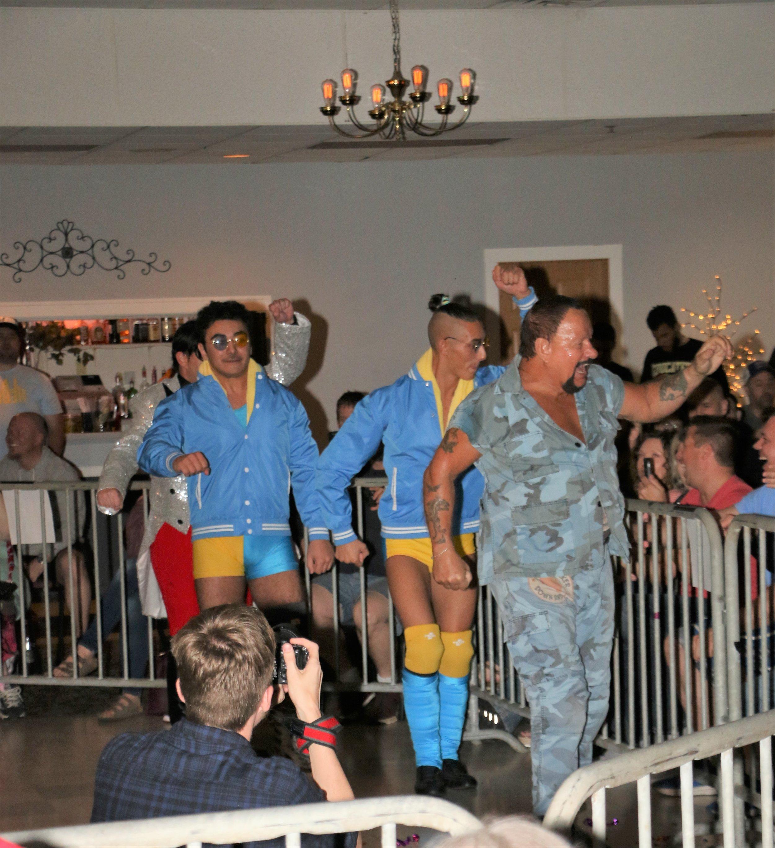 Bushwhacker Luke, from right, Jordan Kross and Kal Herro do the Bushwhacker walk around the ring.