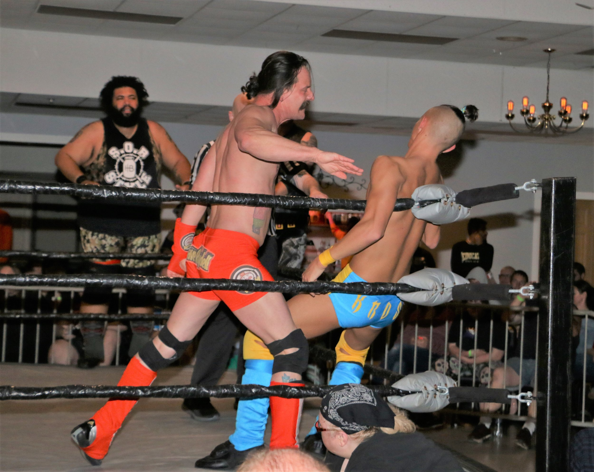 Dave Rydell chops Jordan Kross in the corner during the six-man tag team match.