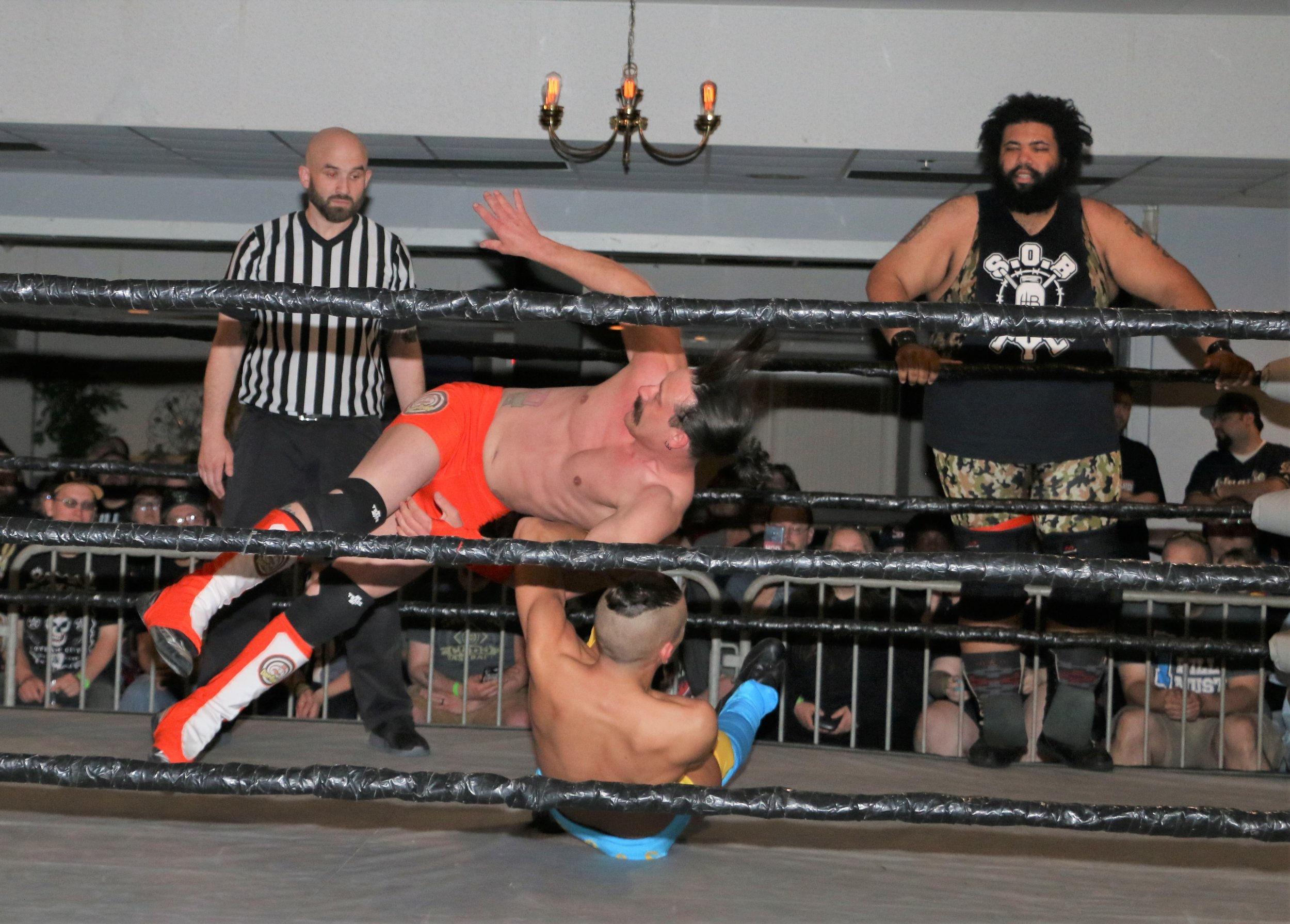 Jordan Kross arm drags Dave Rydell during the six-man tag team match.