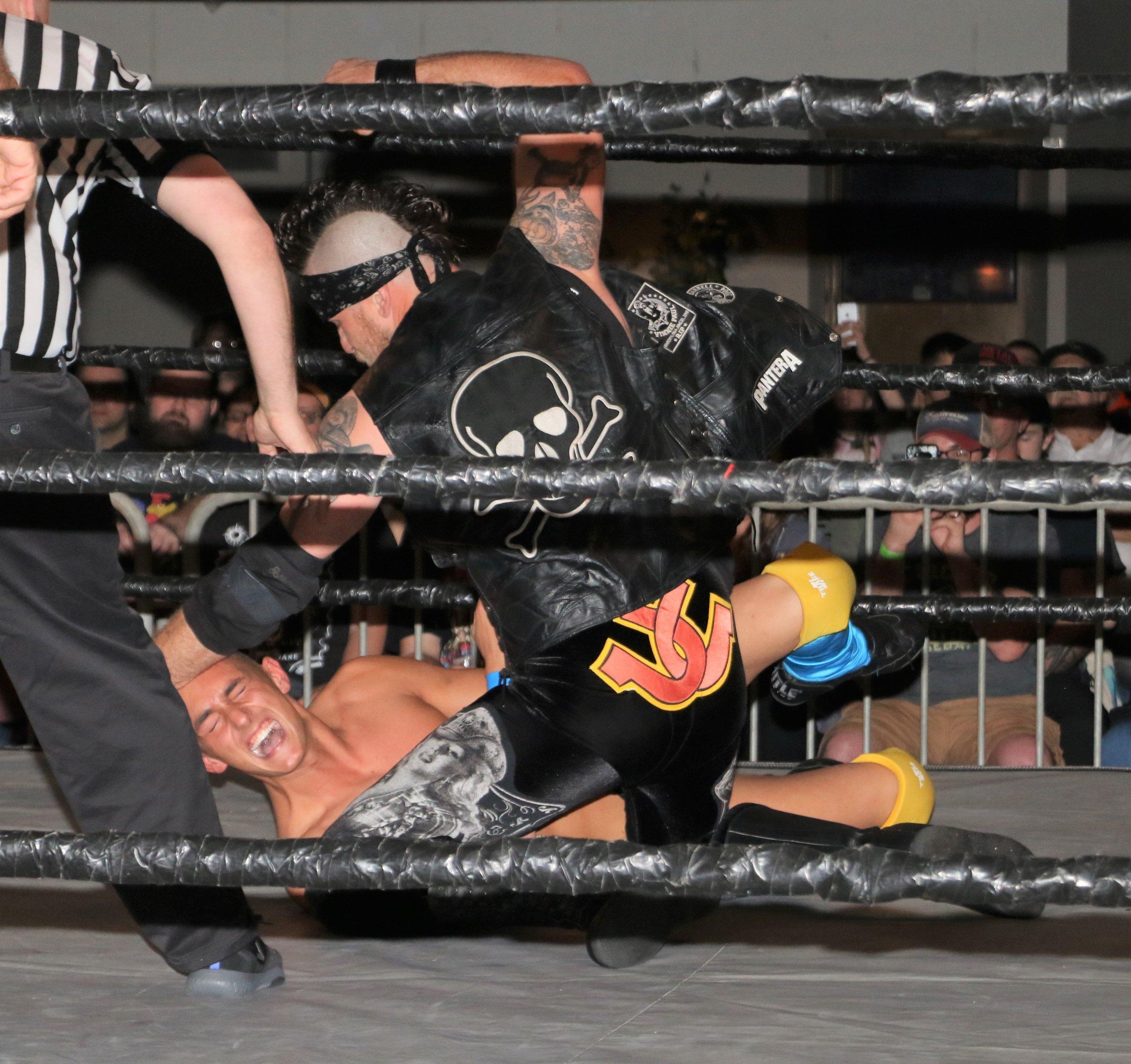 Ruff Crossing pummels Jordan Kross during the six-man tag team match.