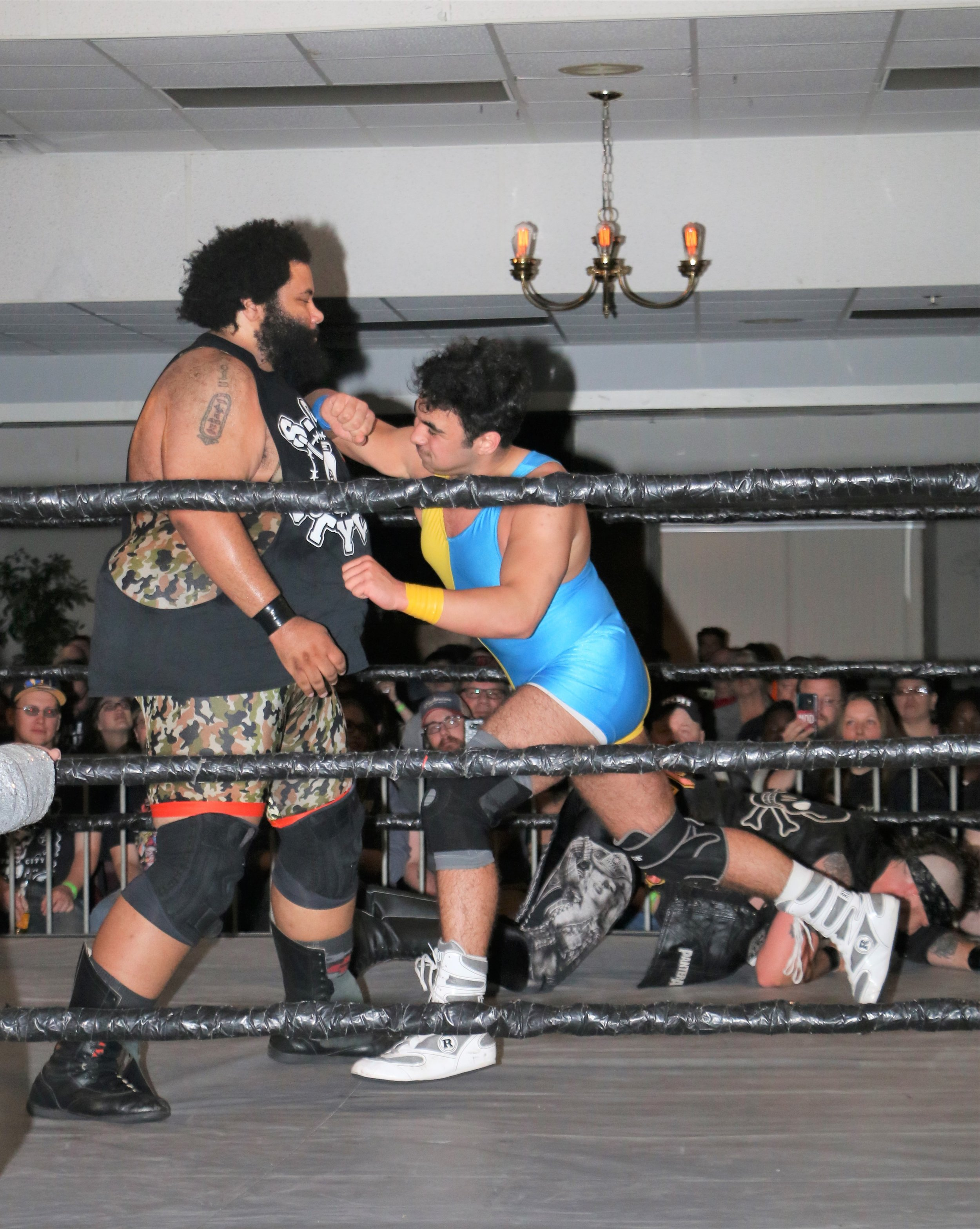 Kal Herro delivers a forearm to Backwoods Brown during the six-man tag team match.
