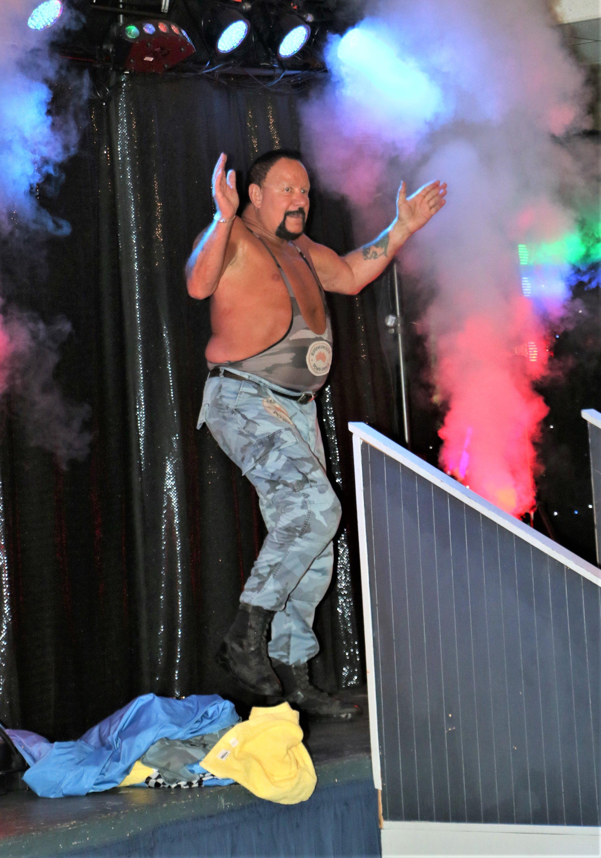 Bushwhacker Luke celebrates on the stage.
