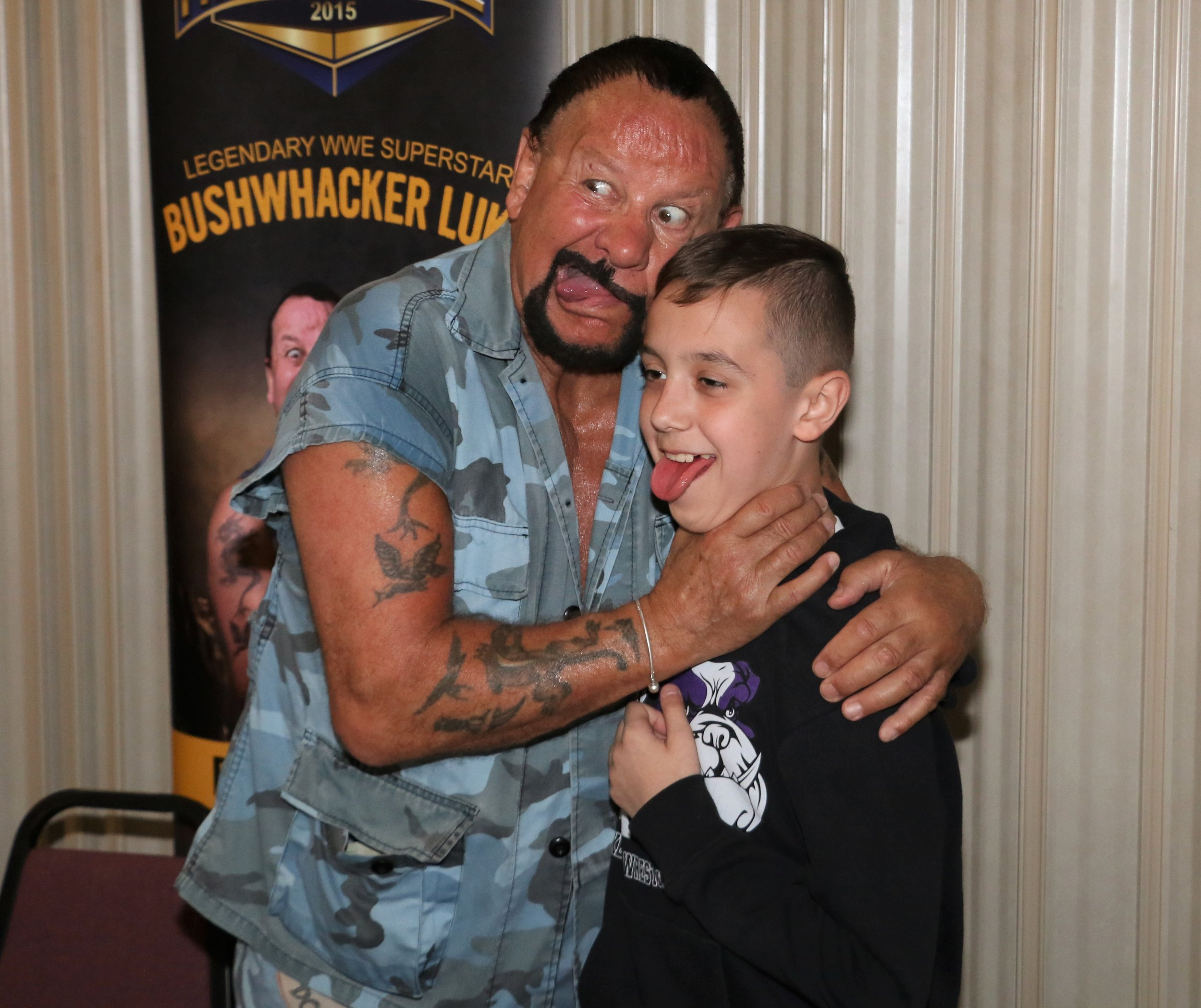 Bushwhacker Luke playfully poses for a picture with a fan.