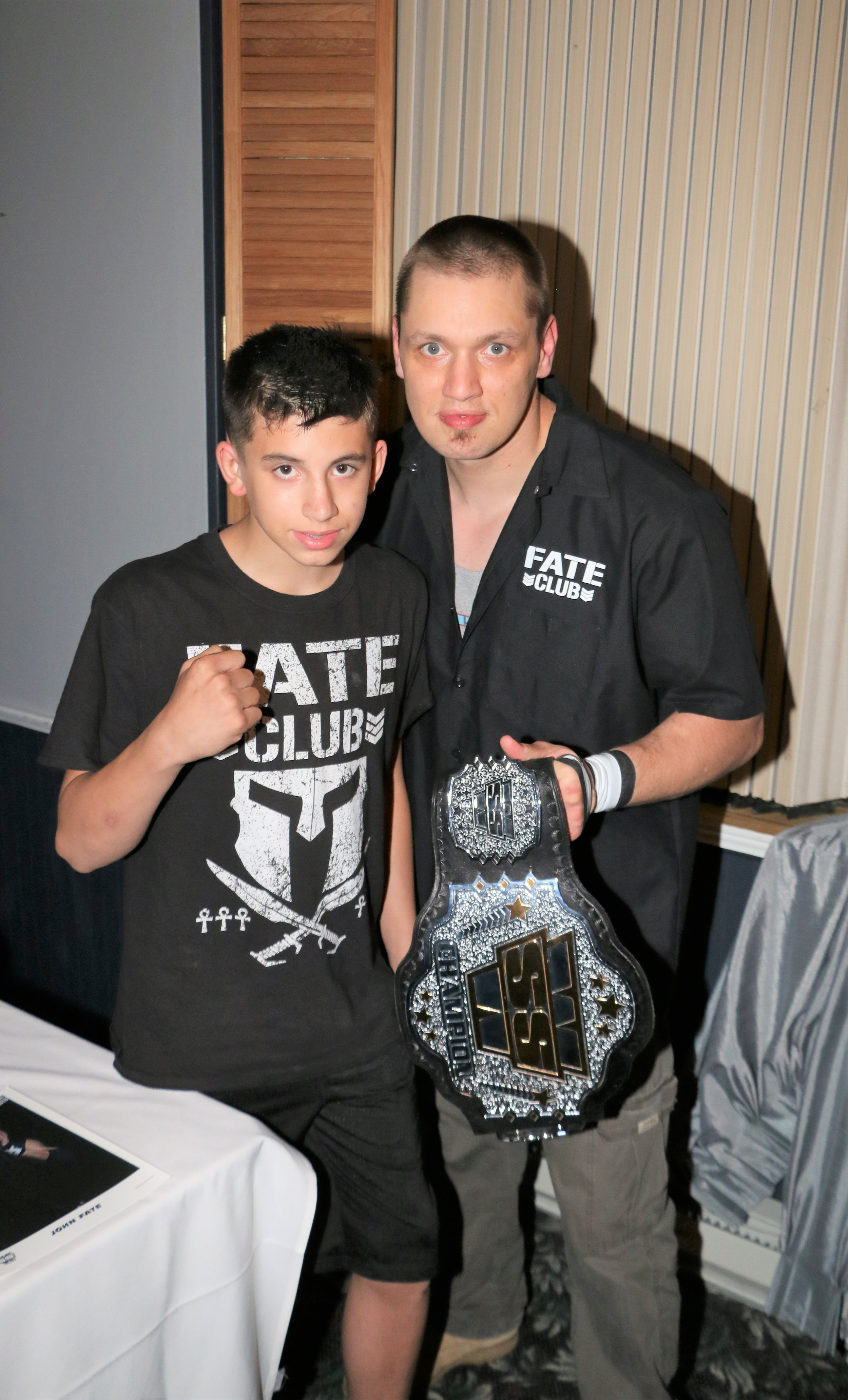 New SSW Champion John Fate poses for a picture with a fan.