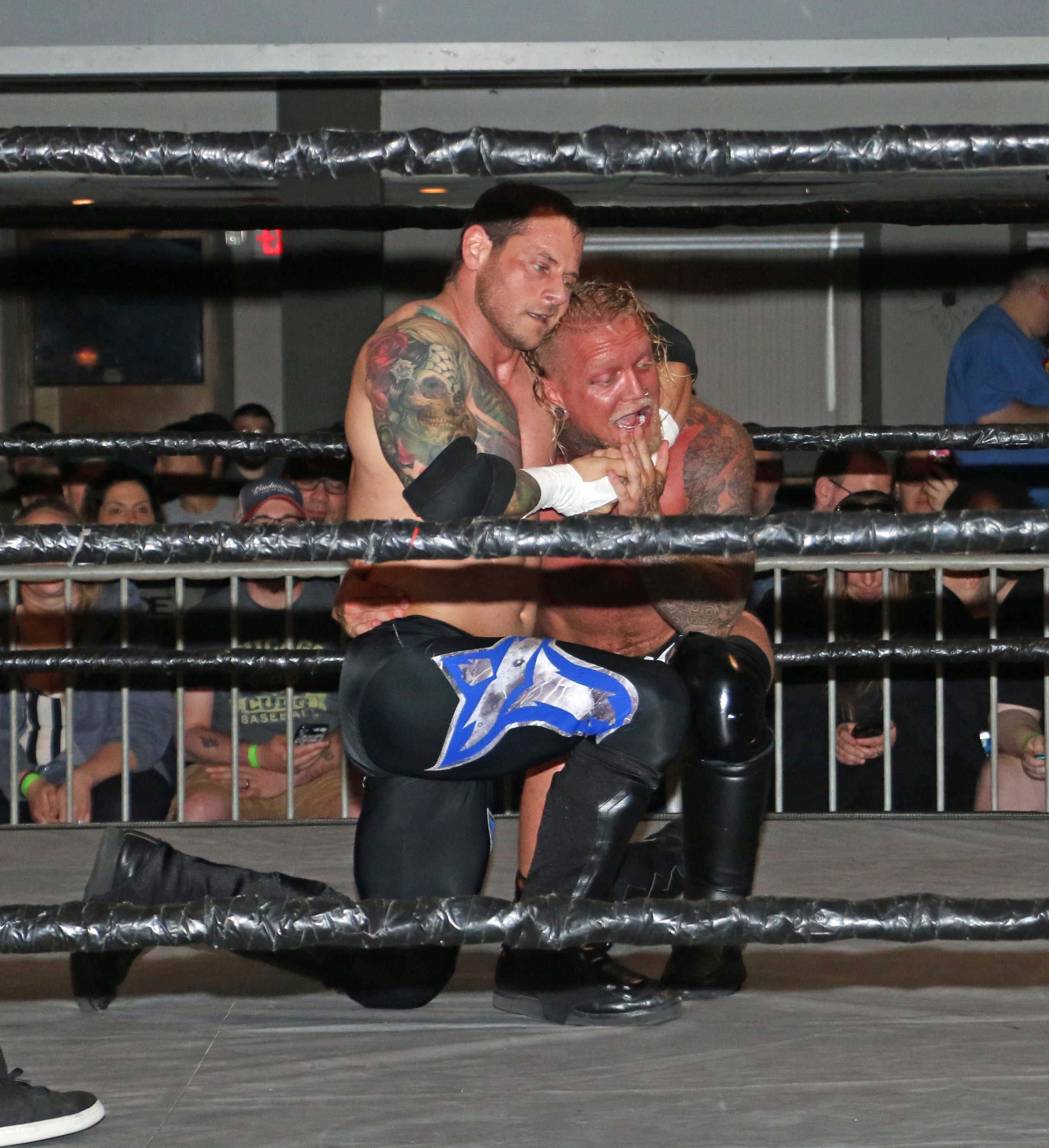 """Ice Pick"" Vic Capri controls ""Filth King"" Brubaker with a headlock."