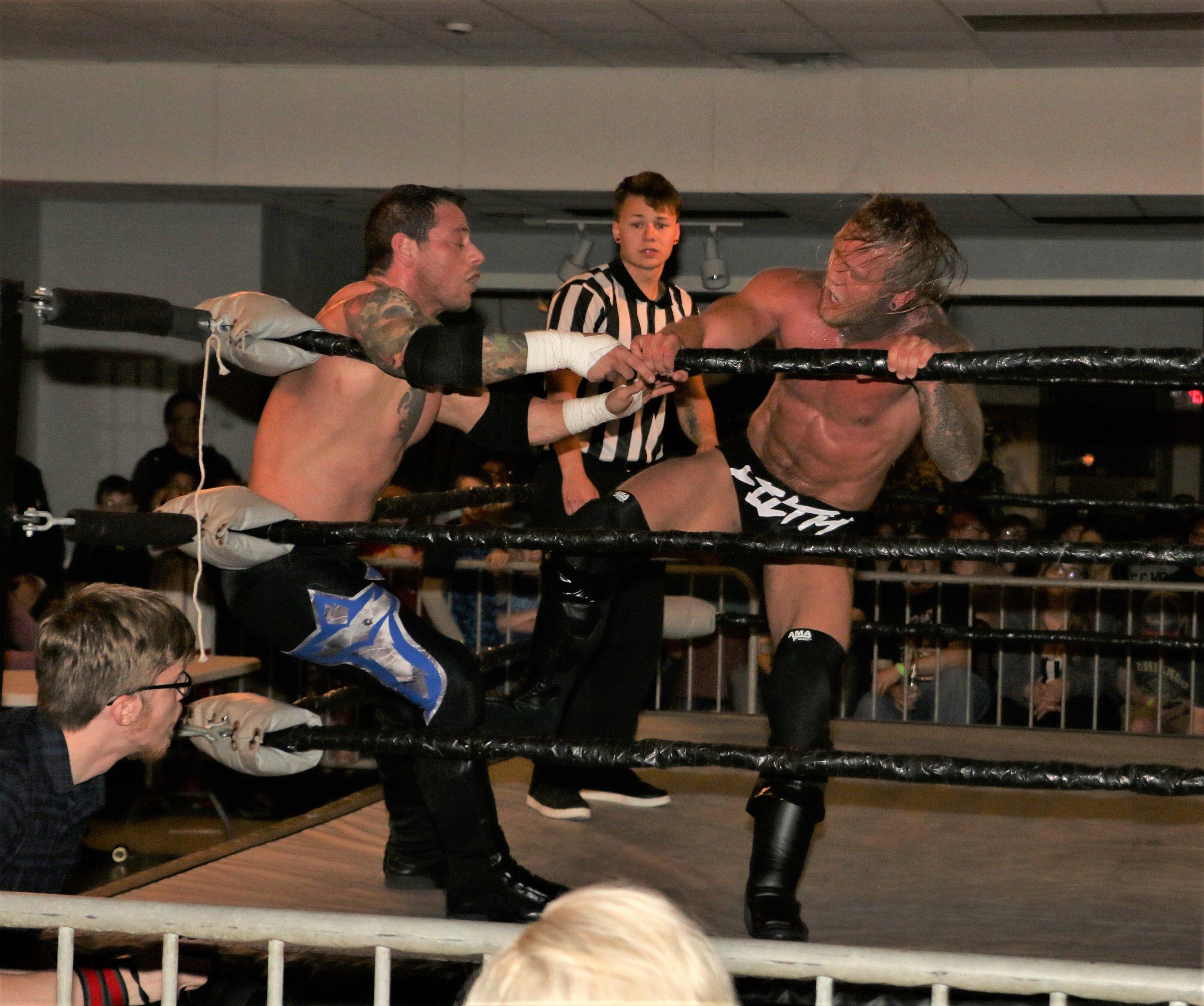 Brubaker kicks Vic Capri in the corner.