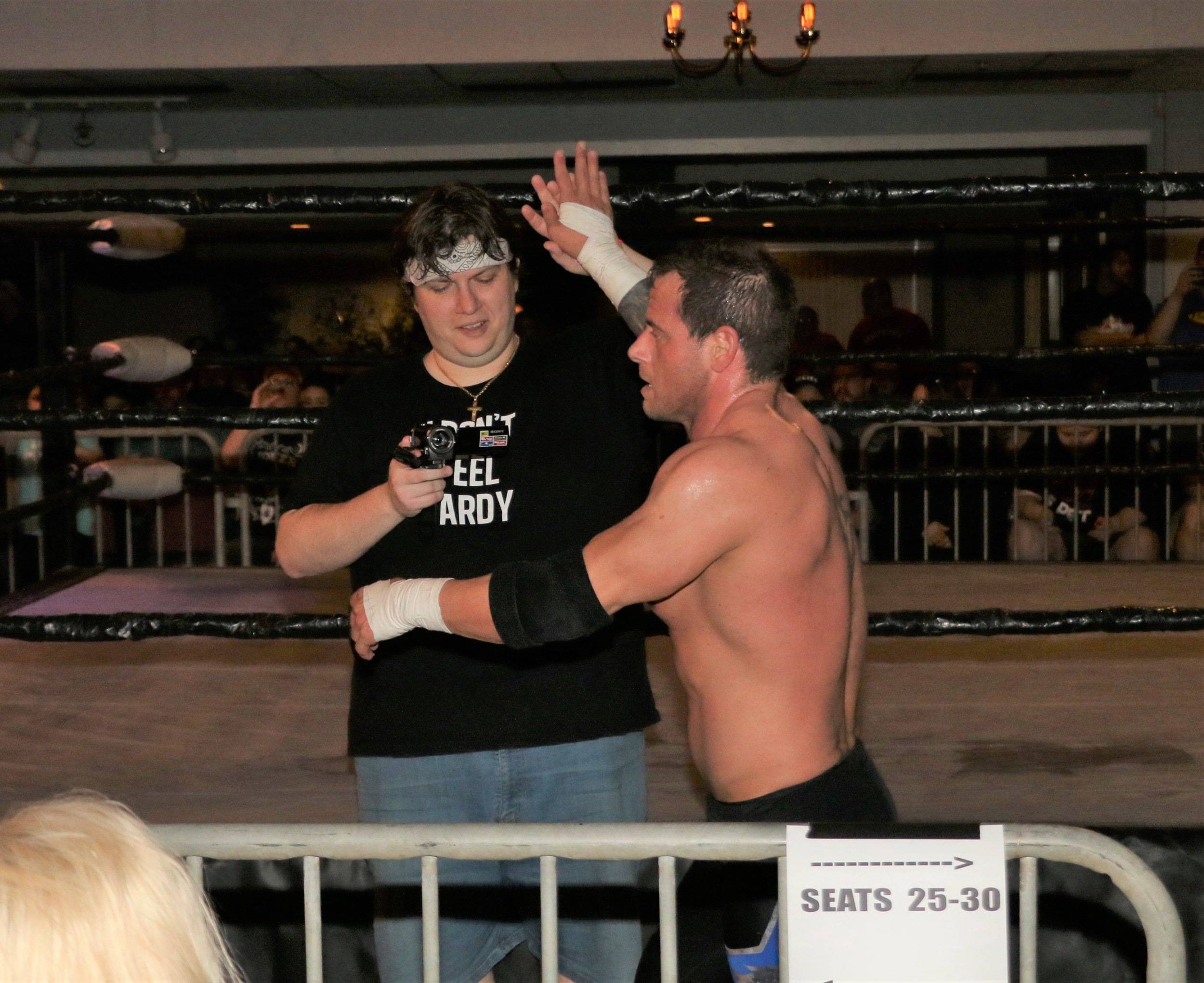 Vic Capri gives a high-five with the ringside videographer.