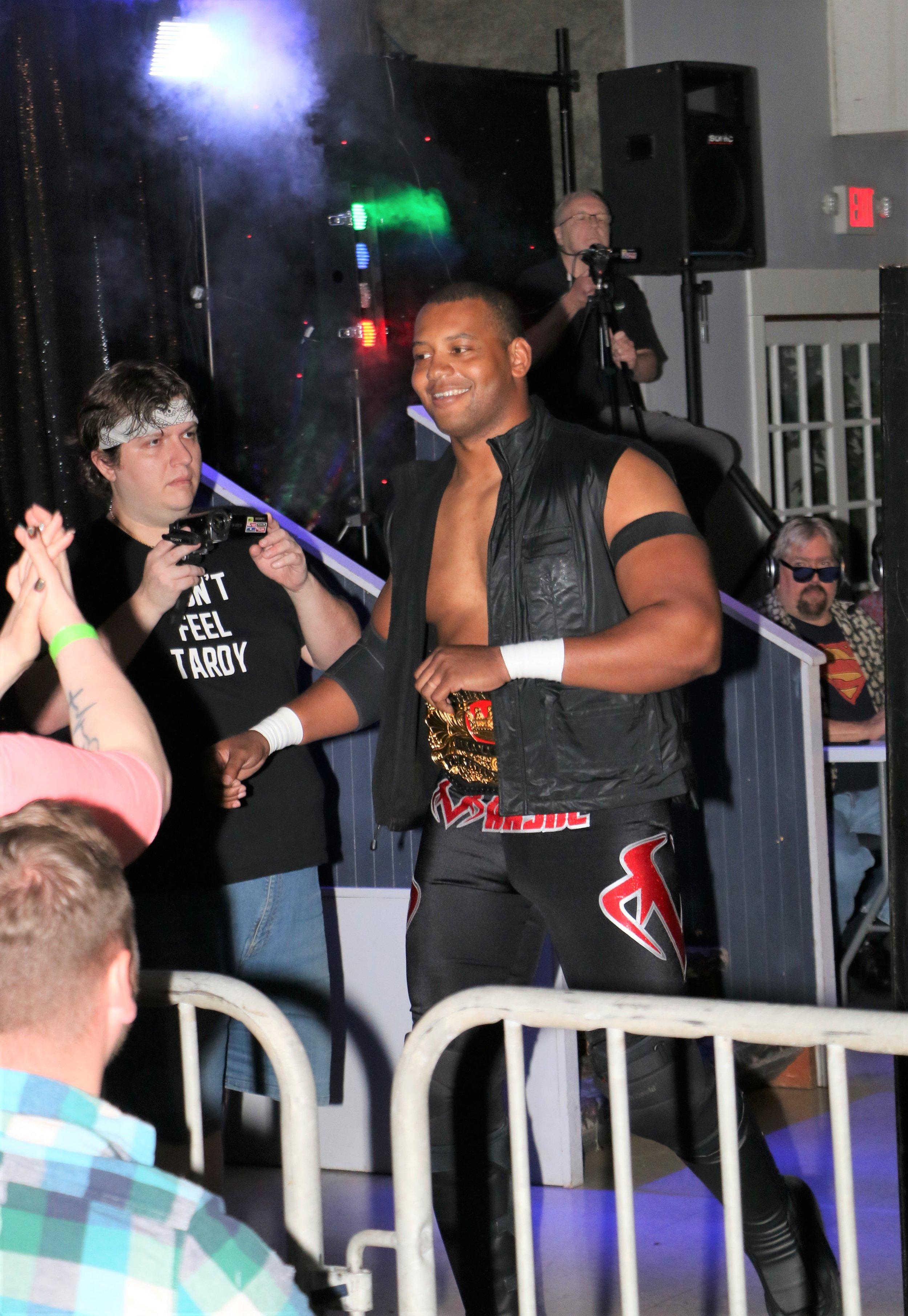 Marshe Rockett greets fans around ringside.