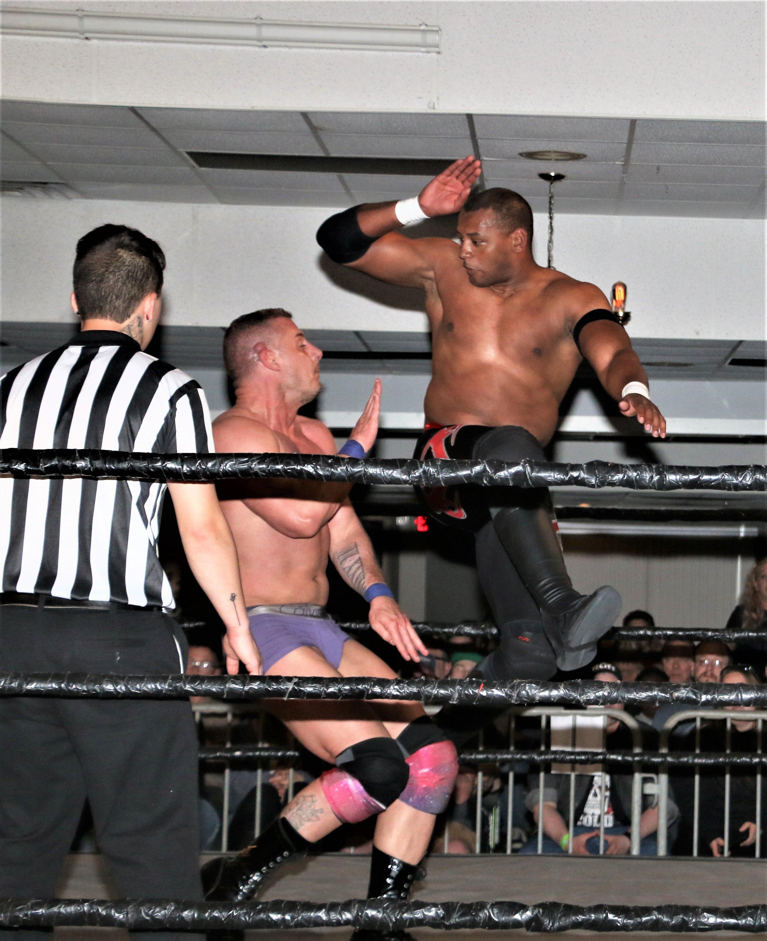 Marshe Rockett hits the spinning heel kick on Eric Priest.