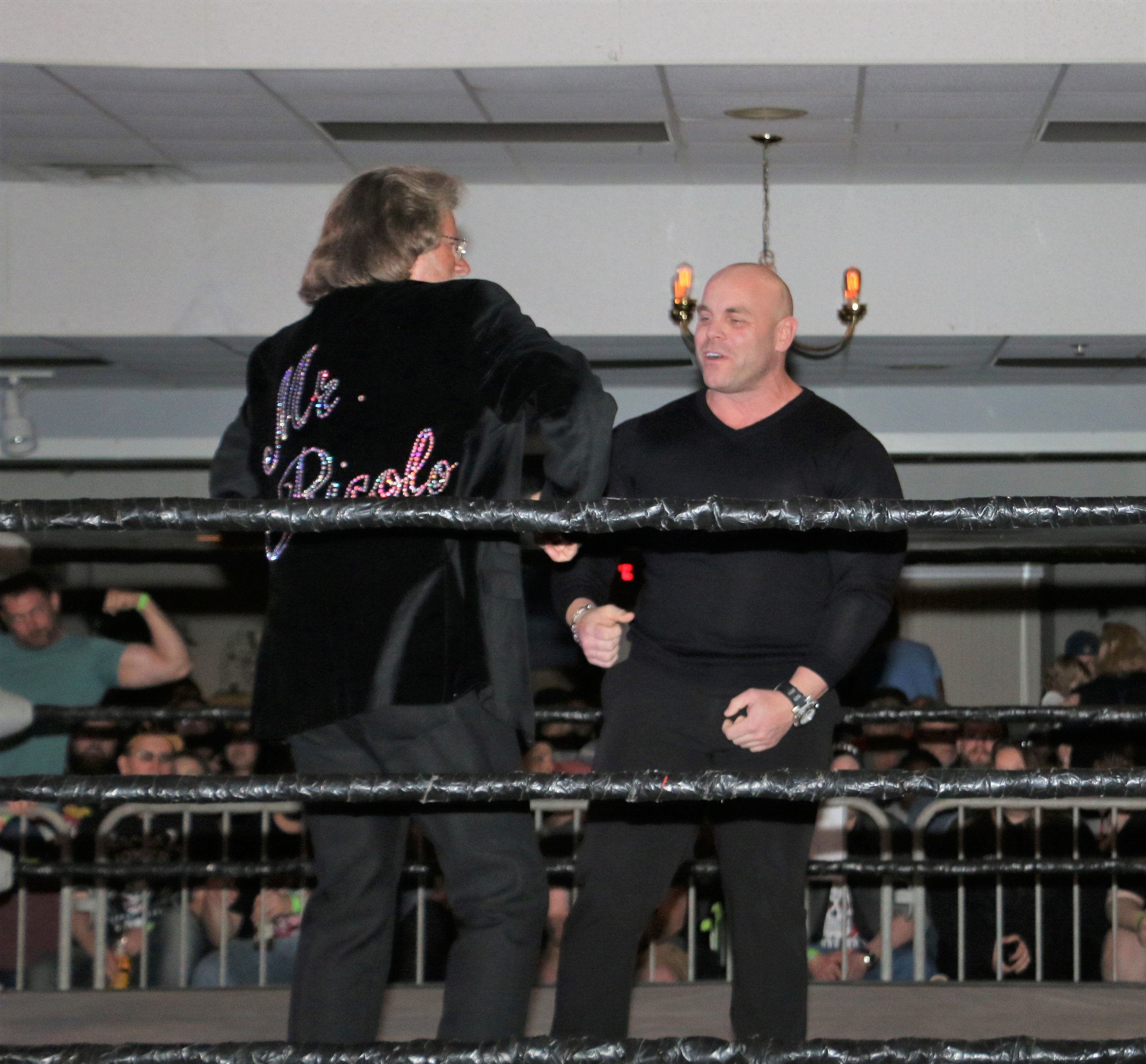 Mr. Ricolo greets bodybuilder David Baye.