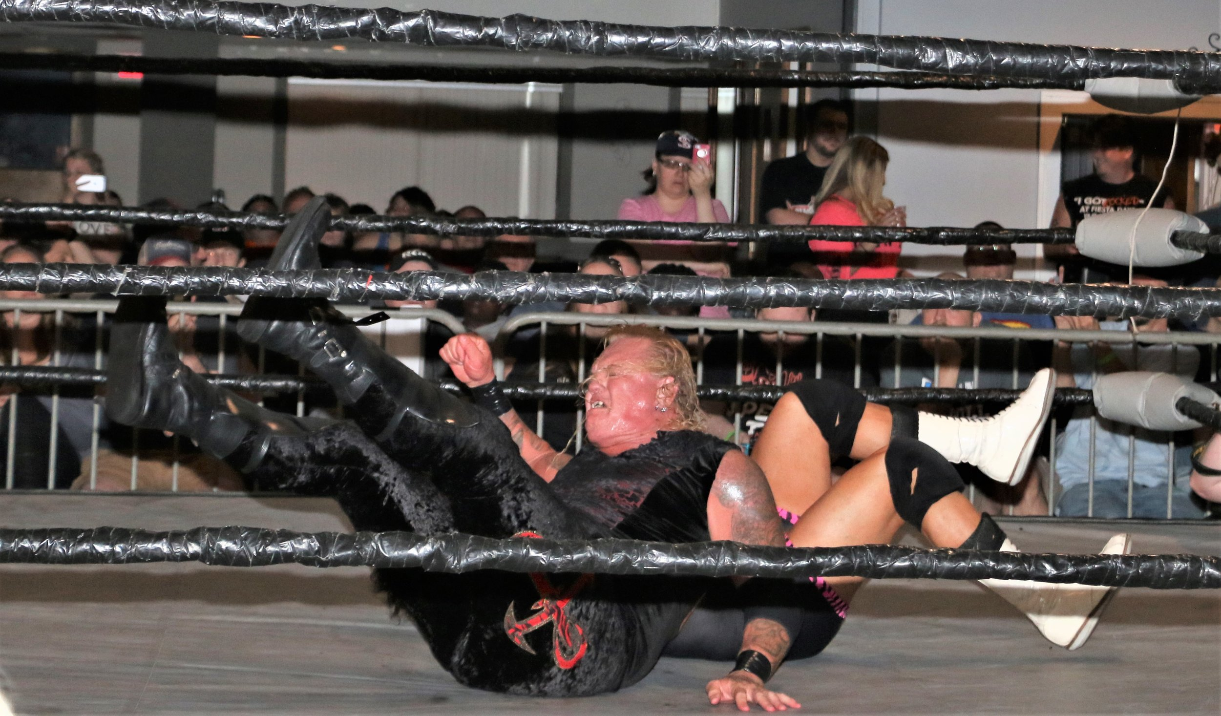 Gangrel drops an elbow on Dr. Jeff Luxon.