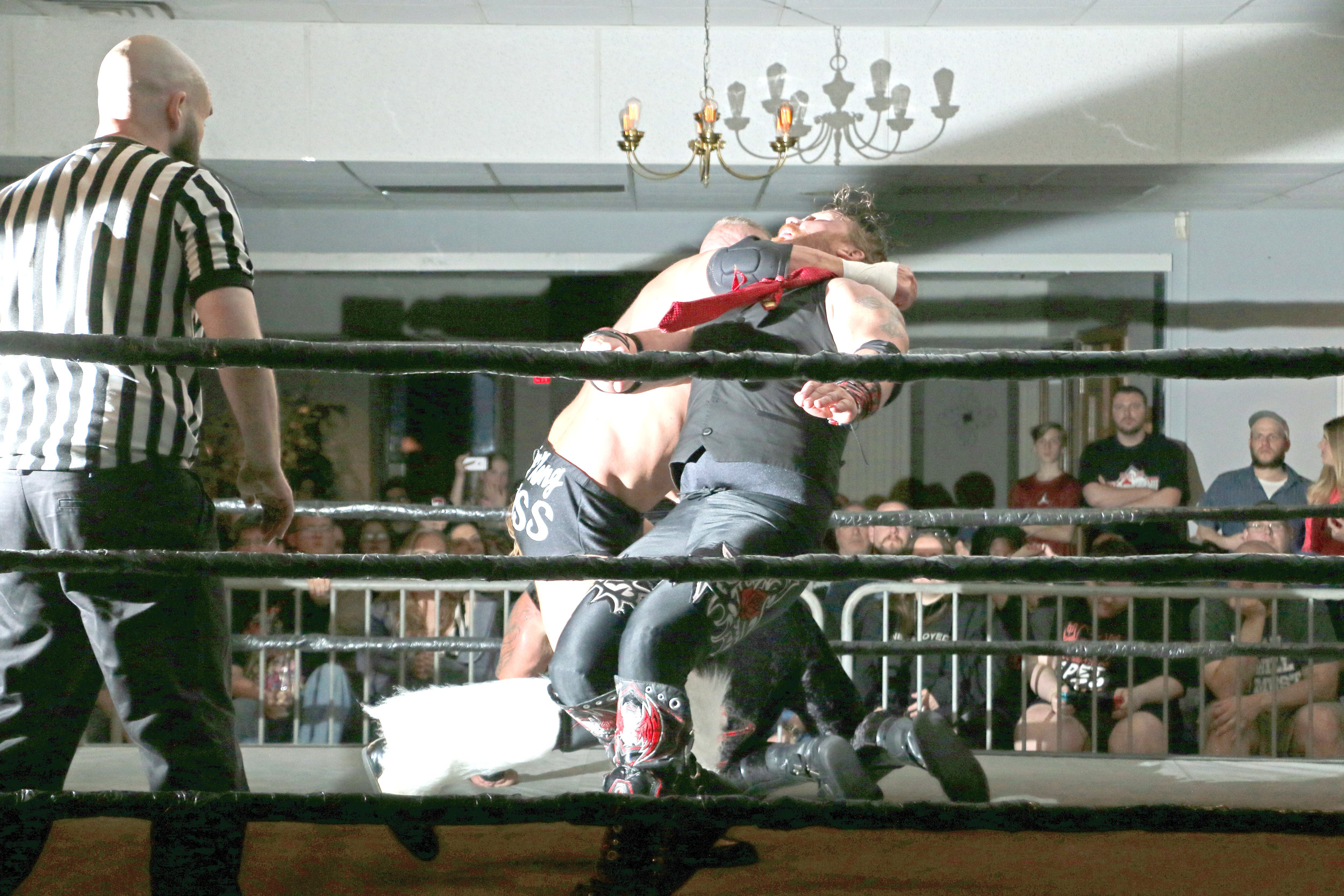 Ryan Kross clotheslines Kevin Thorn during the tag-team main event.