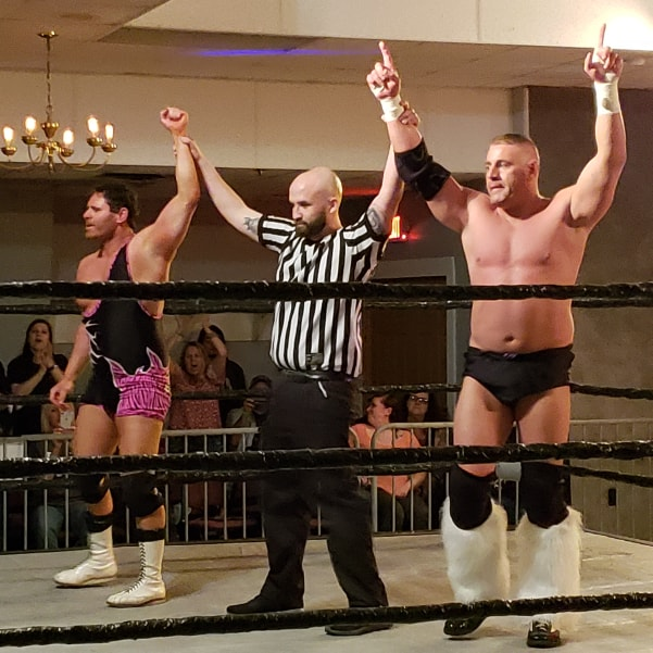 The referee raises the hands of Dr. Jeff Luxon, left, and Ryan Kross after their victory over Gangrel and Kevin Thorn.  (Photo by Rich LoCascio)
