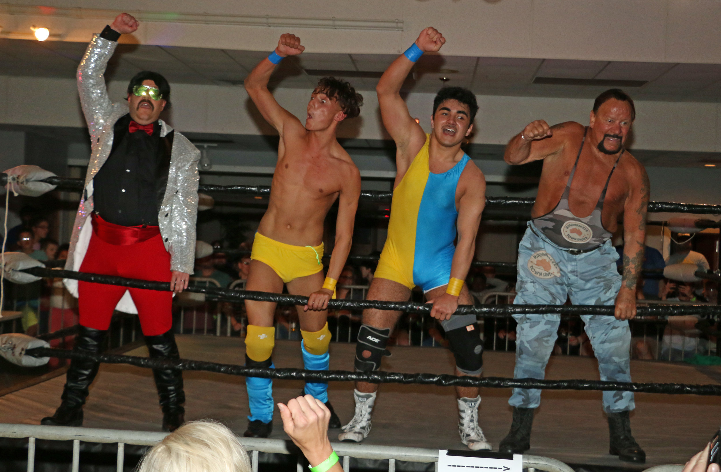Manager Sidney Bakabella, from left, Jordan Kross, Kal Herro and WWE Hall of Famer Bushwhacker Luke celebrate victory at Sunday's SSW/SNS SuperShow 2 in Kenosha, Wis.  (Photo by Mike Pankow)