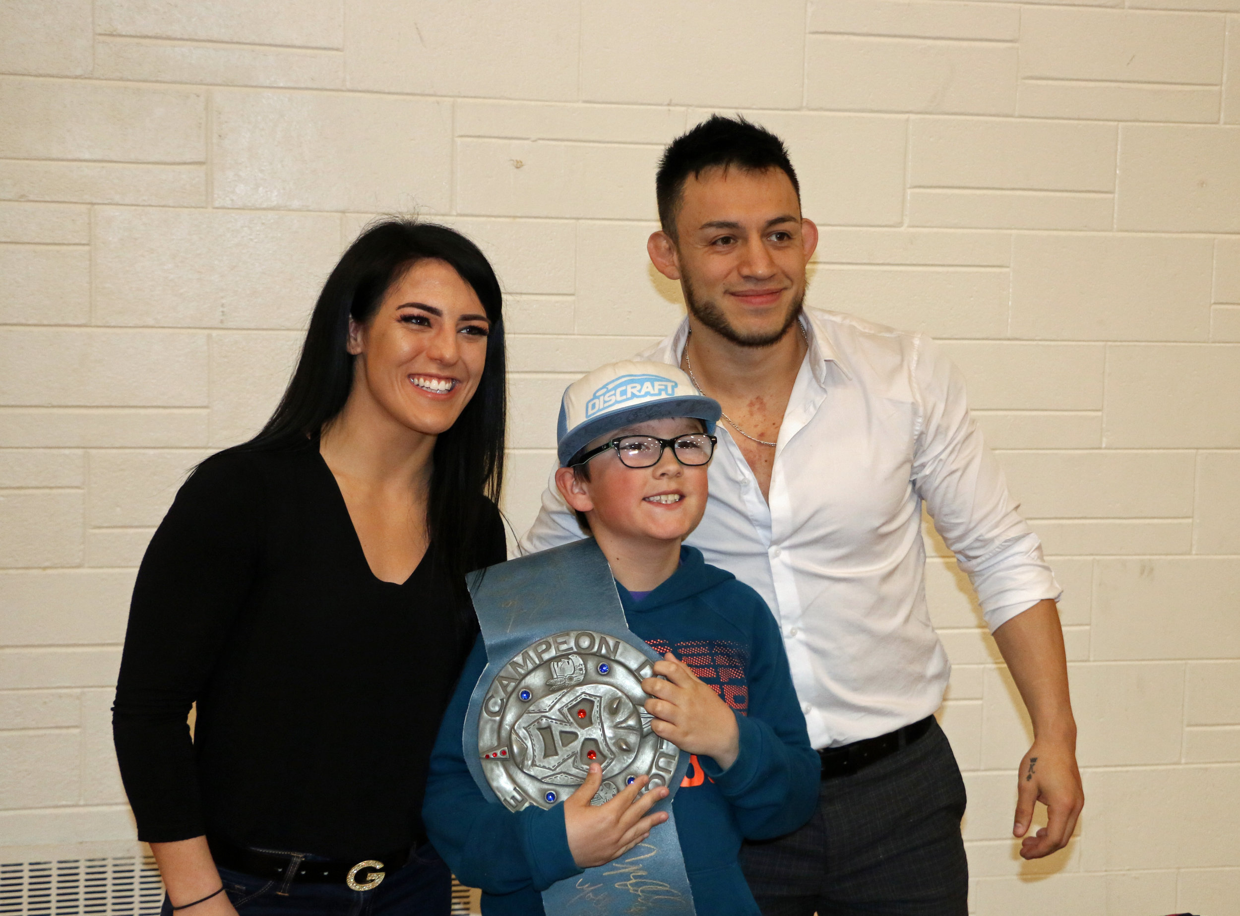 Tessa Blanchard, left, and Daga, right, pose with a young fan at the Warrior Wrestling 5 fan fest on May 12.  (Photo by Mike Pankow)