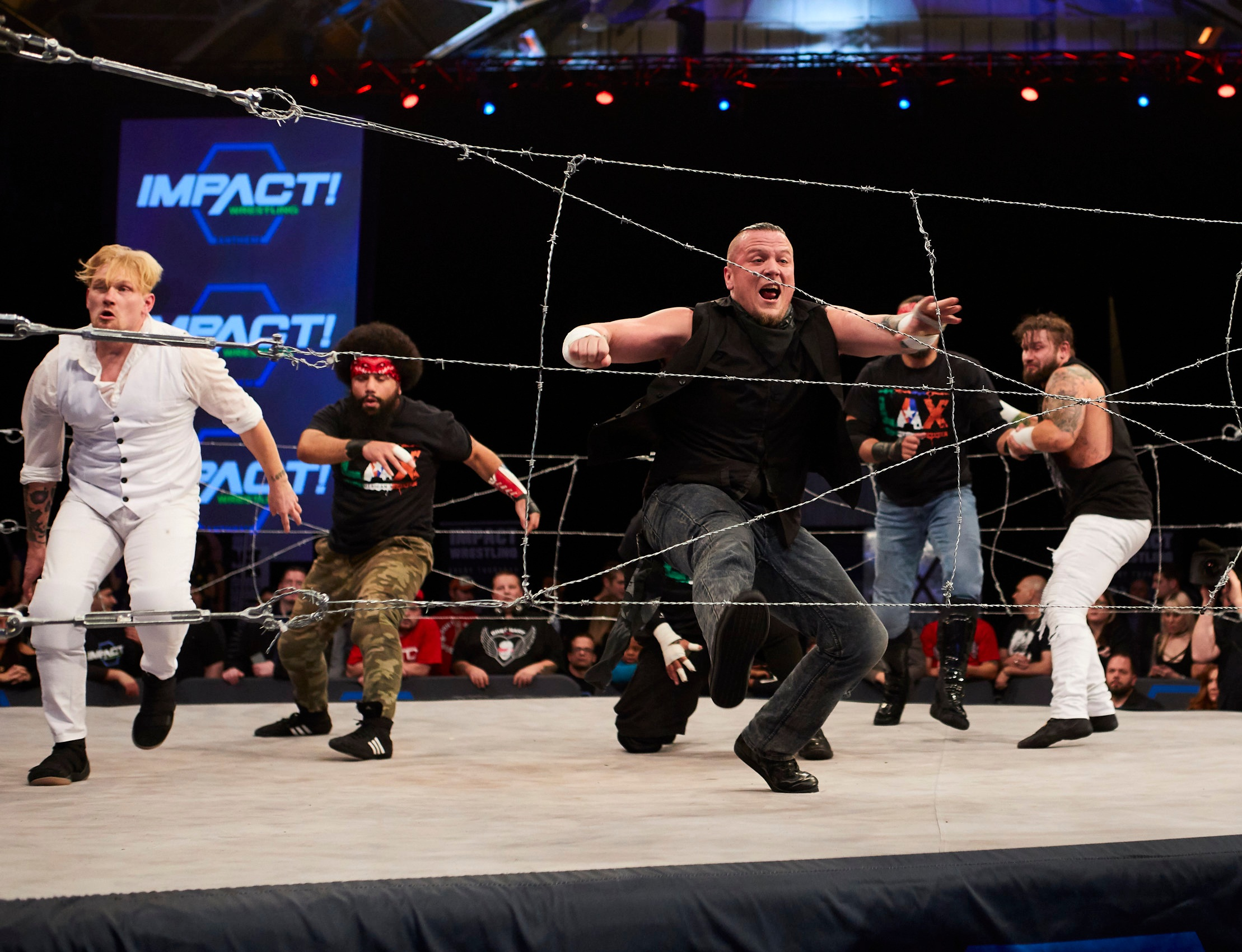 Sami Callihan, center, during oVe's Barbed Wire Masscare match against LAX in Jan. 2018. Callihan, who is one of IMPACT Wrestling's hottest acts with his unique look, brawling style and no-nonsense attitude, will face Tessa Blanchard at Slammiversary on July 7.  (Photo courtesy IMPACT Wrestling)