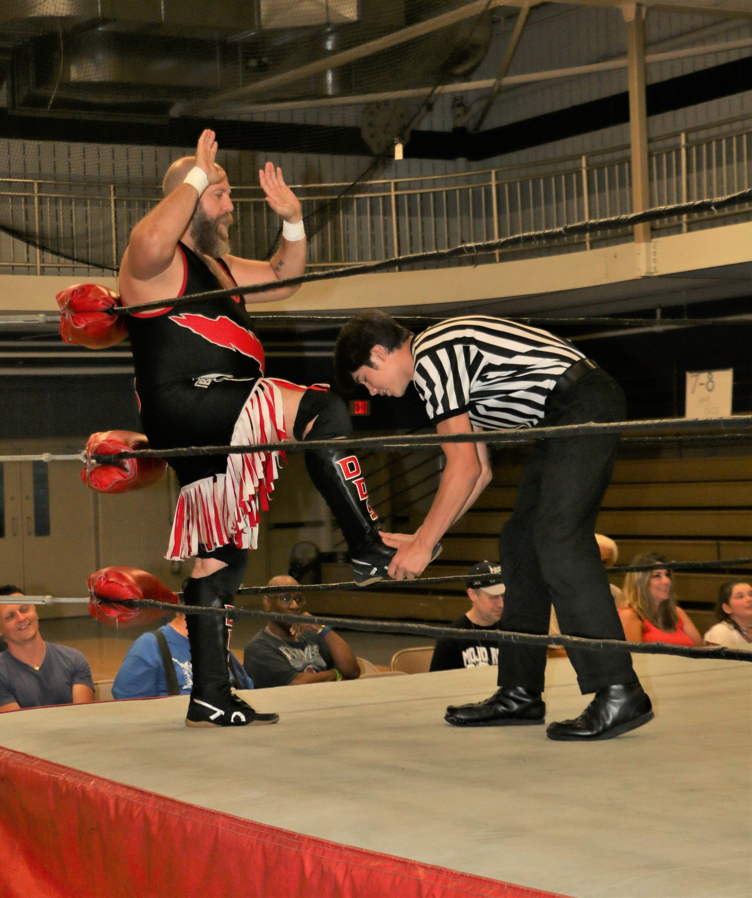 The referee checks DDS before his match against Alex Riley.