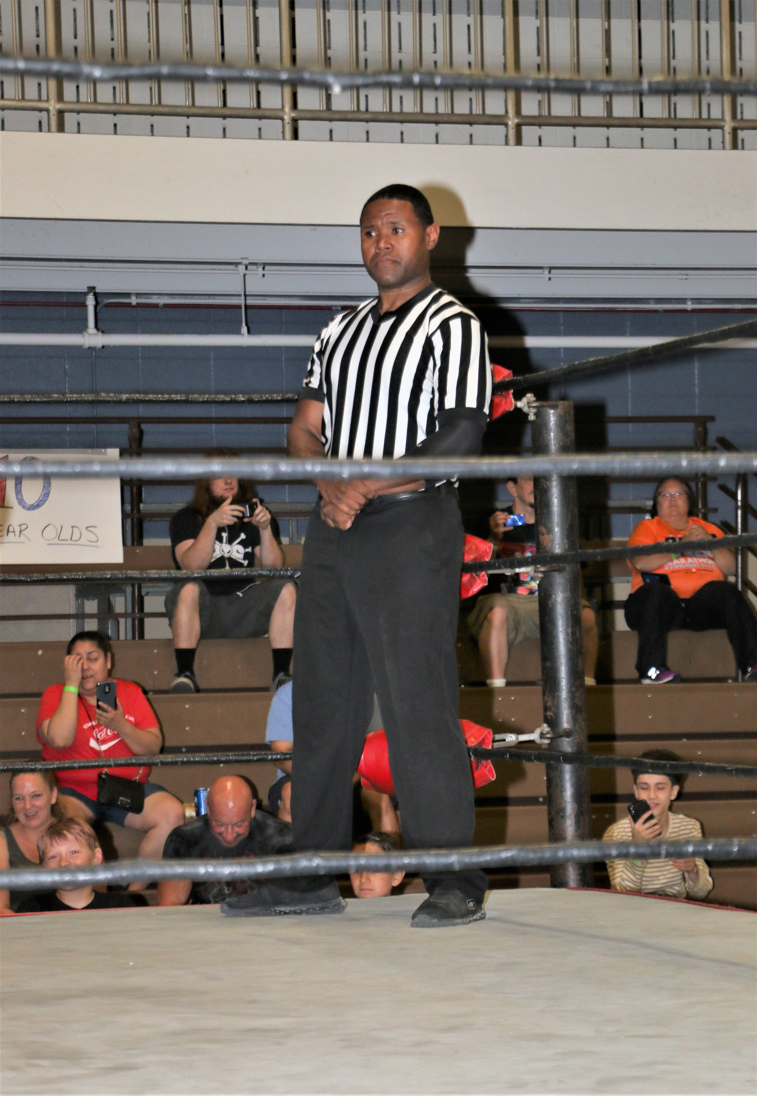 Referee Jessie Bush awaits the competitors for the next match.