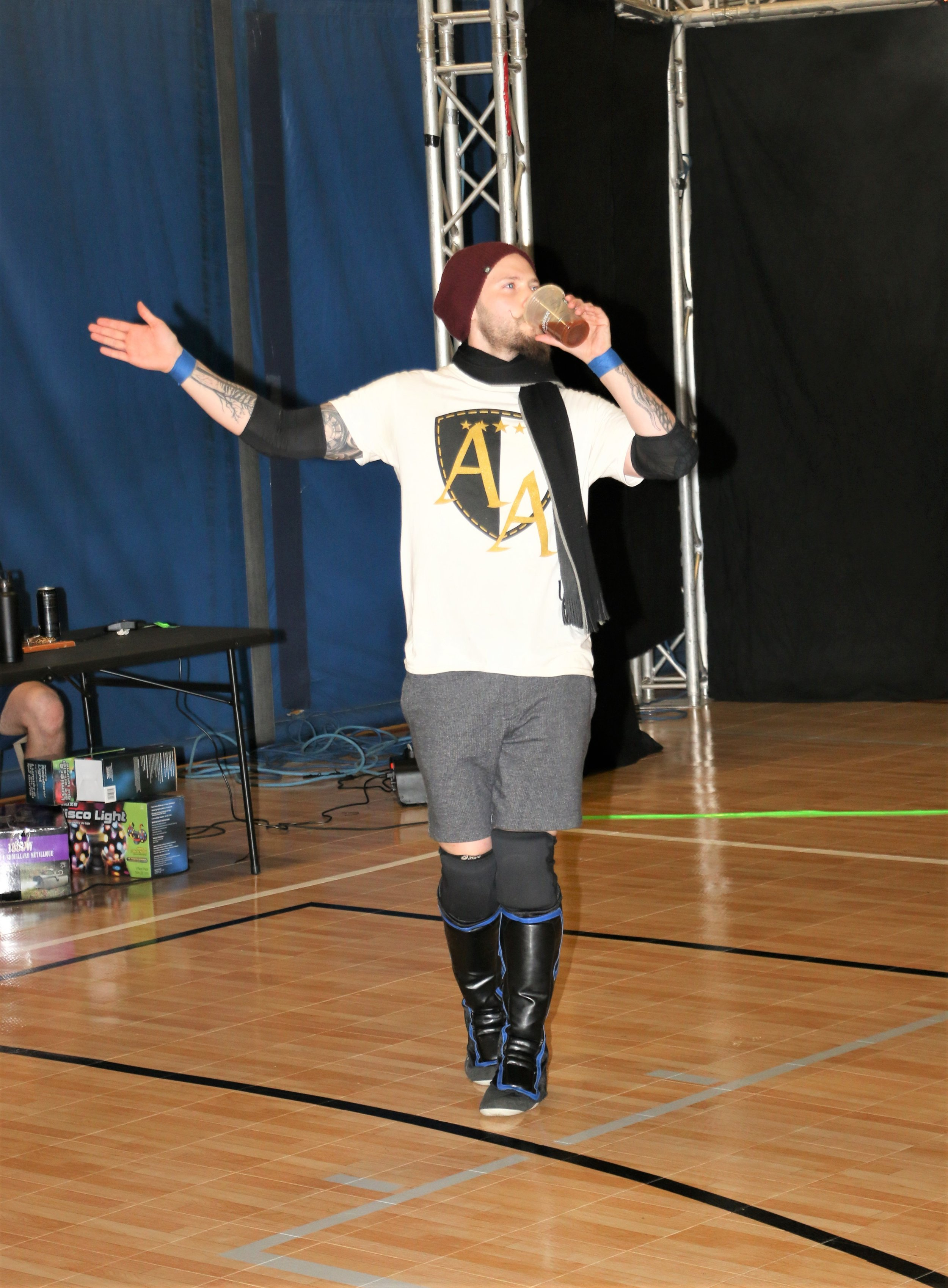 """Hipster Hunk"" Aaron Arsenal enters the arena for the six-man scramble match."