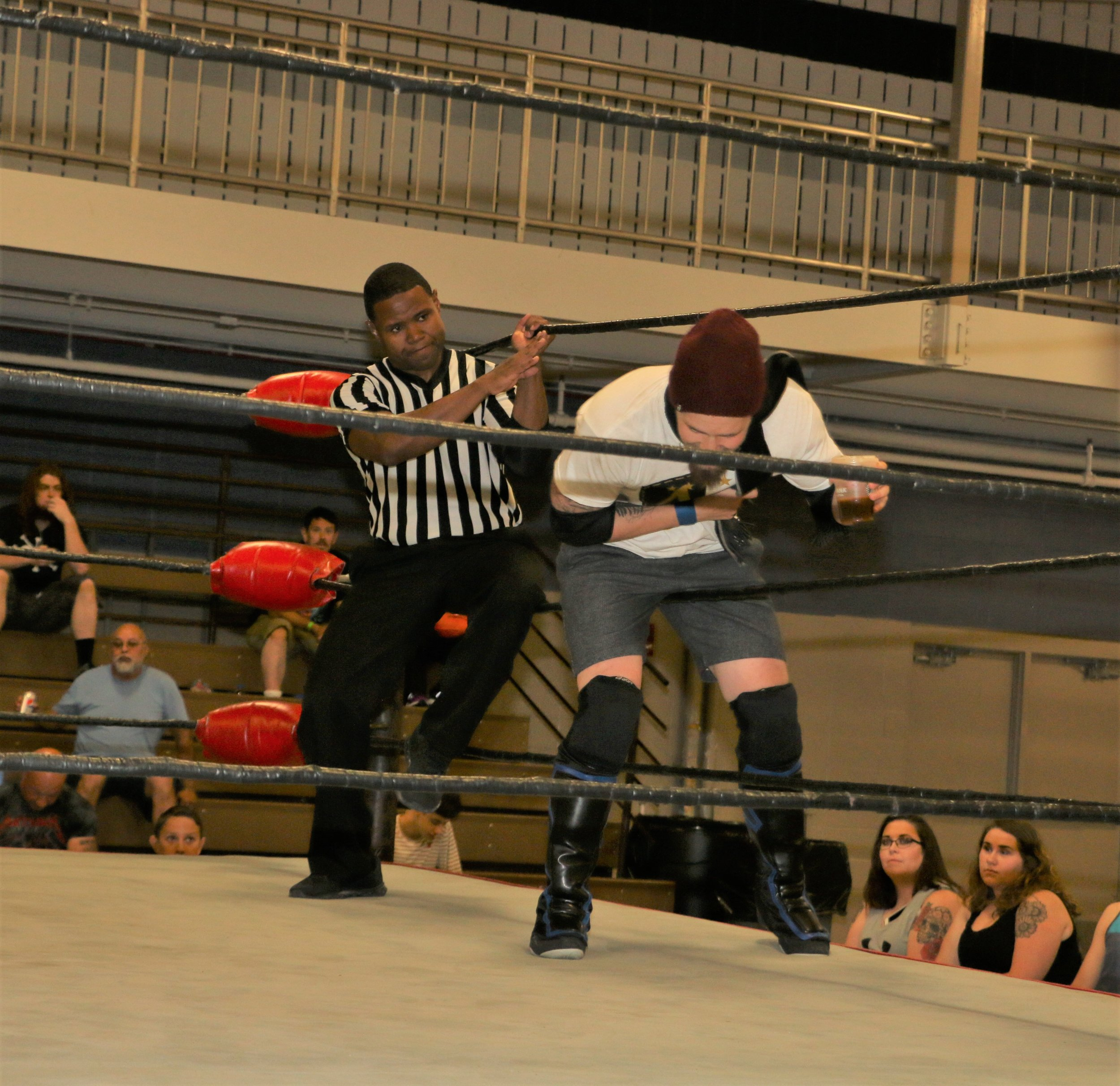 Referee Jessie Bush held the ropes for Aaron Arsenal.