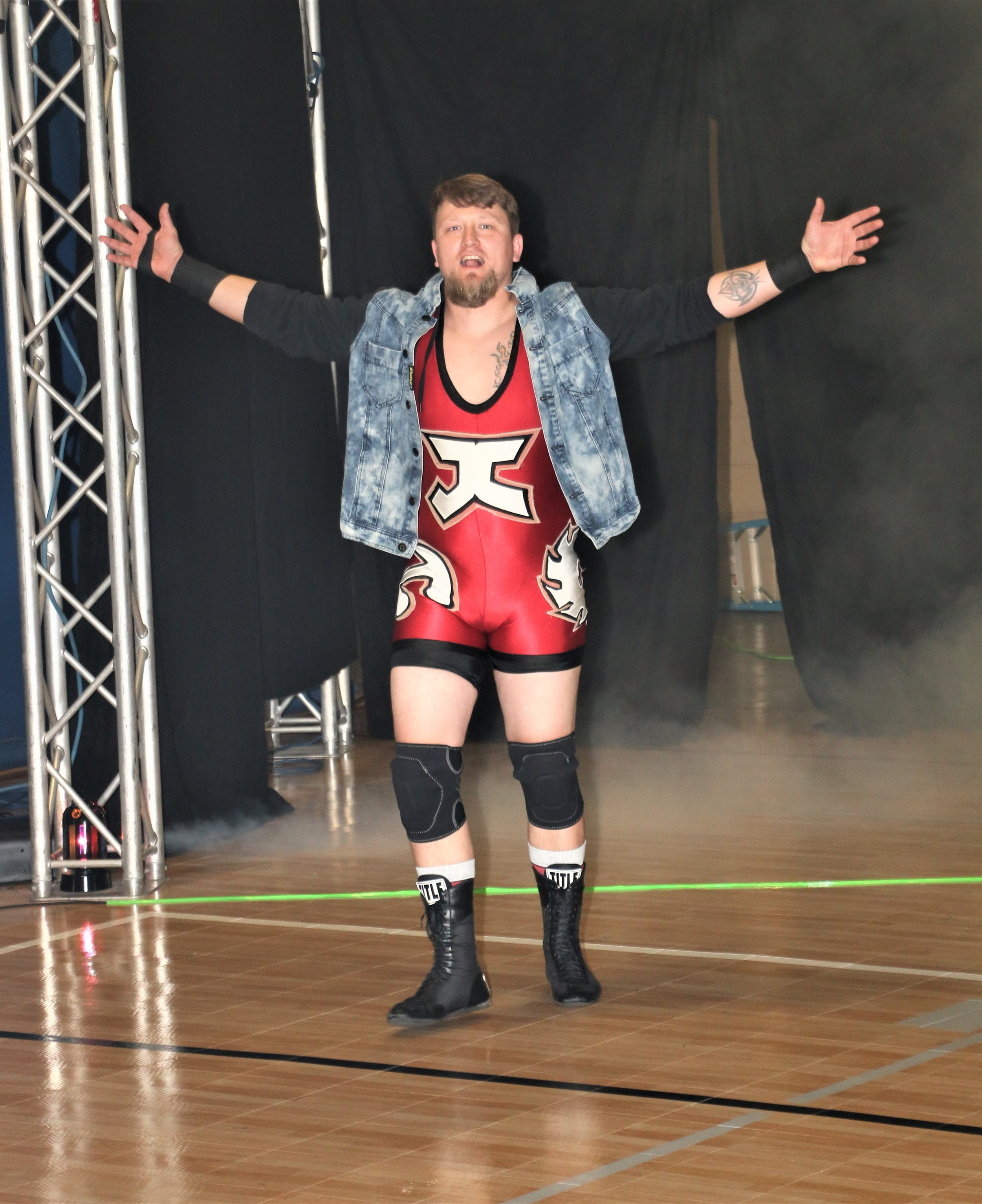"""Working Class Hero"" Jack Carpenter enters the arena for the six-man scramble match."