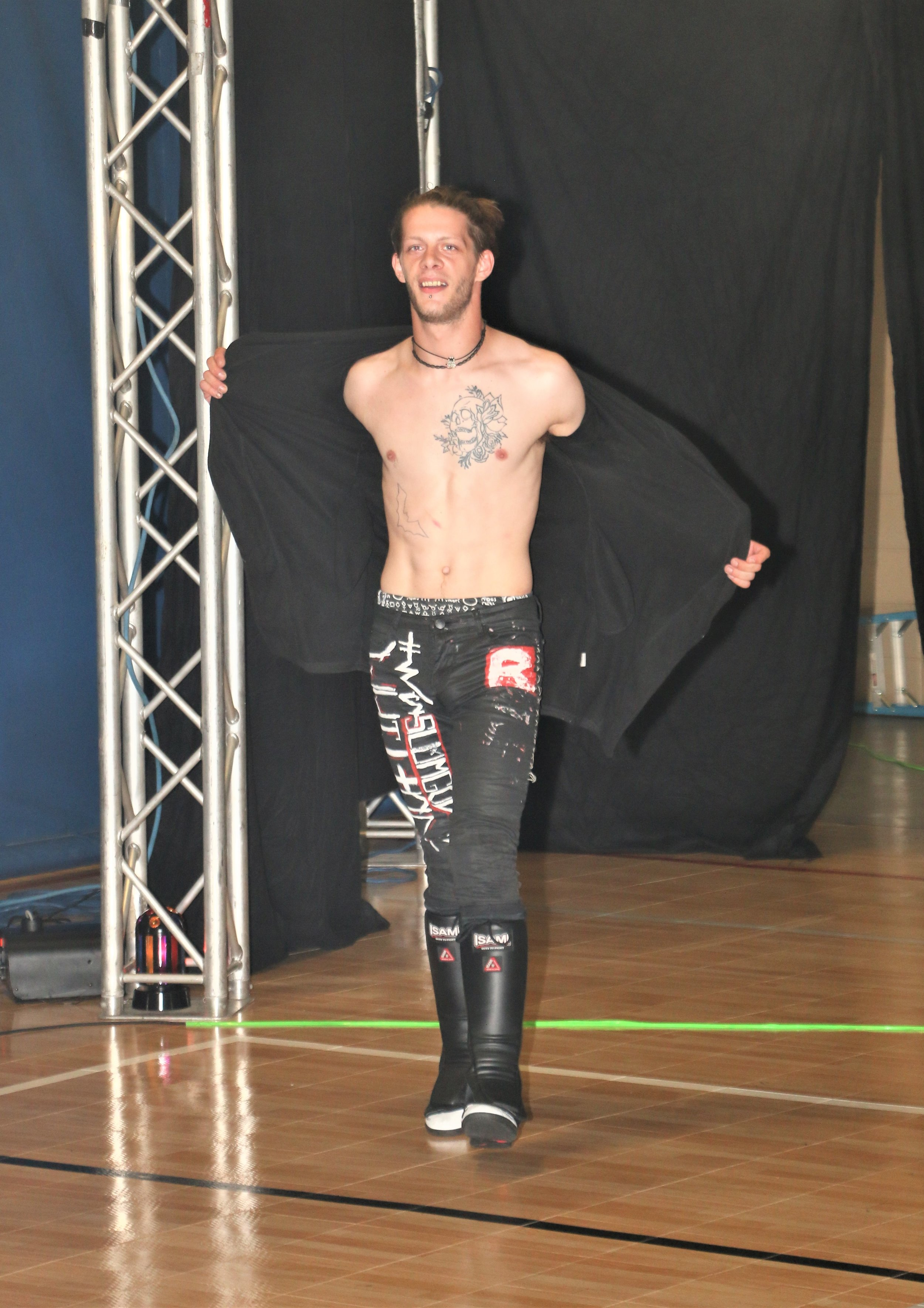 """Slumgod"" Quinn Whittock enters the arena for the six-man scramble match."