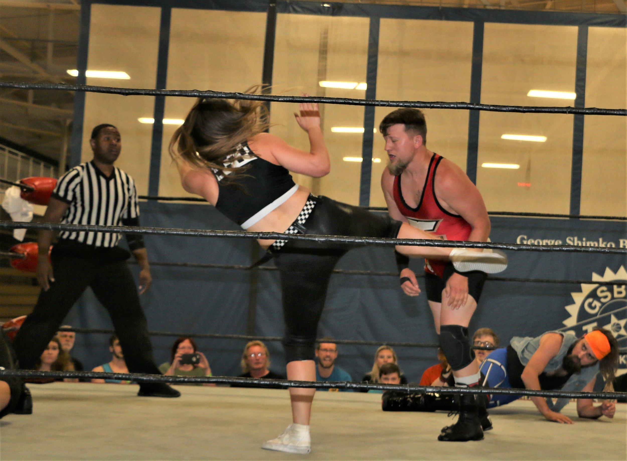 Missa Kate kicks Jack Carpenter.