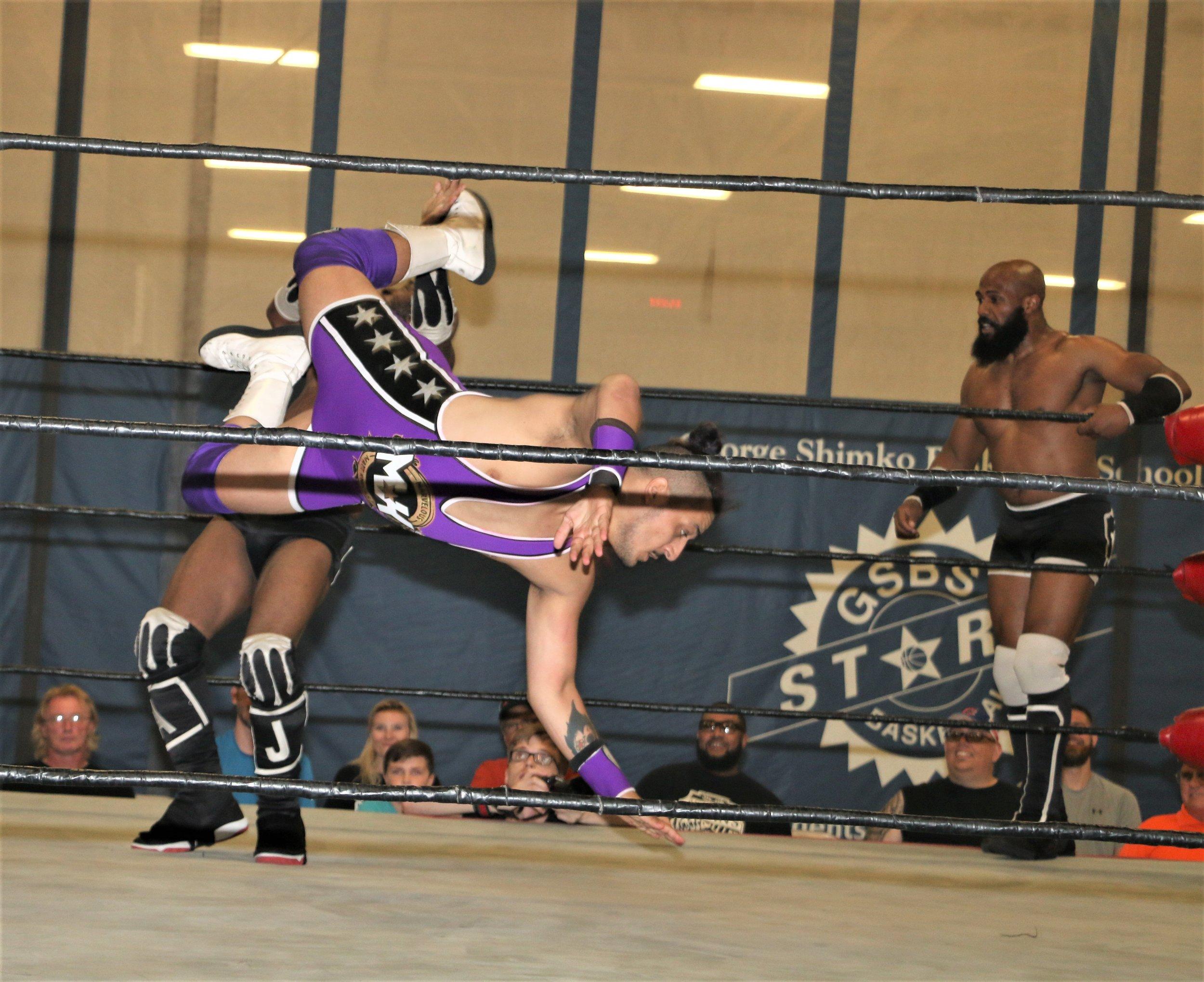Matt Knicks dropkicks Acid Jaz during their tag-team match.