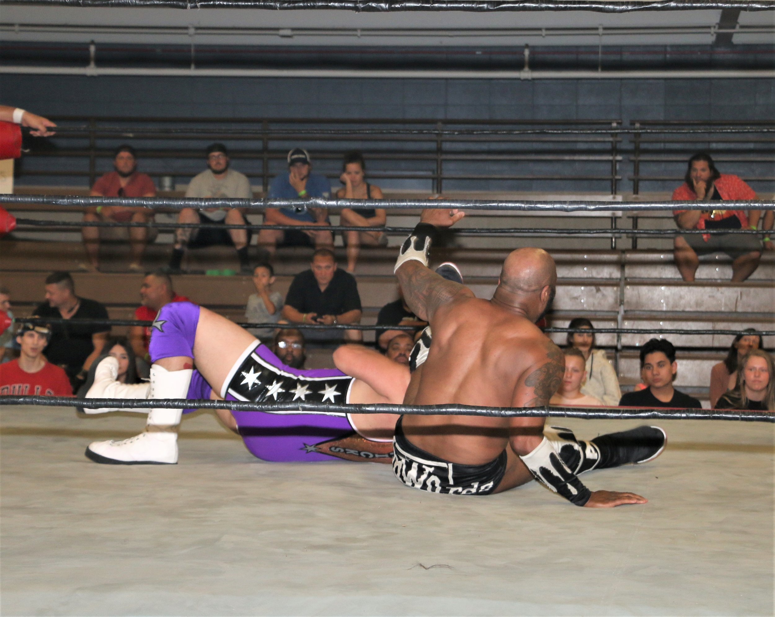 Acid Jaz legdrops Matt Knicks during the tag-team match.