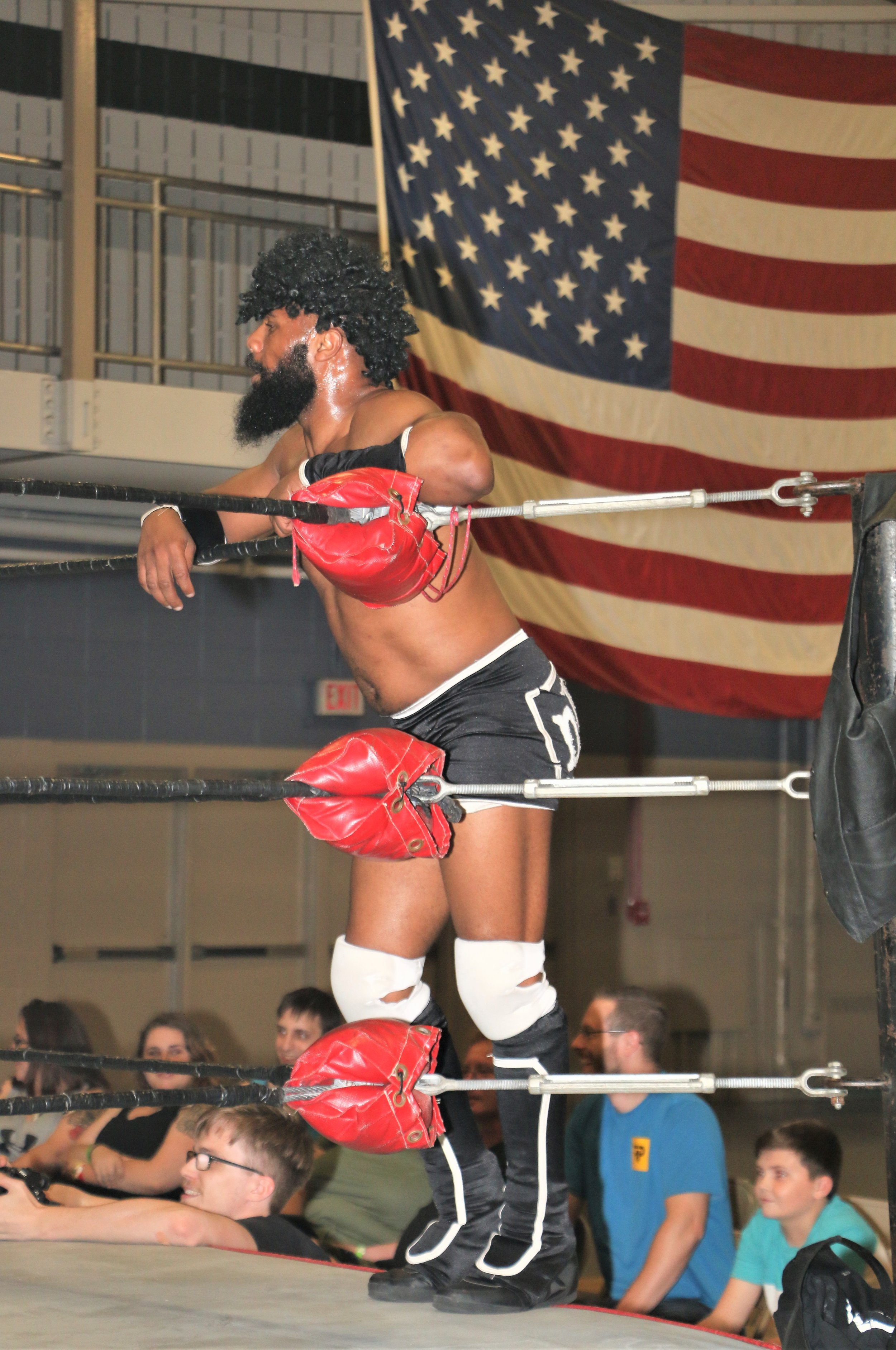 Bryce Benjamin sports a wig on the ring apron.