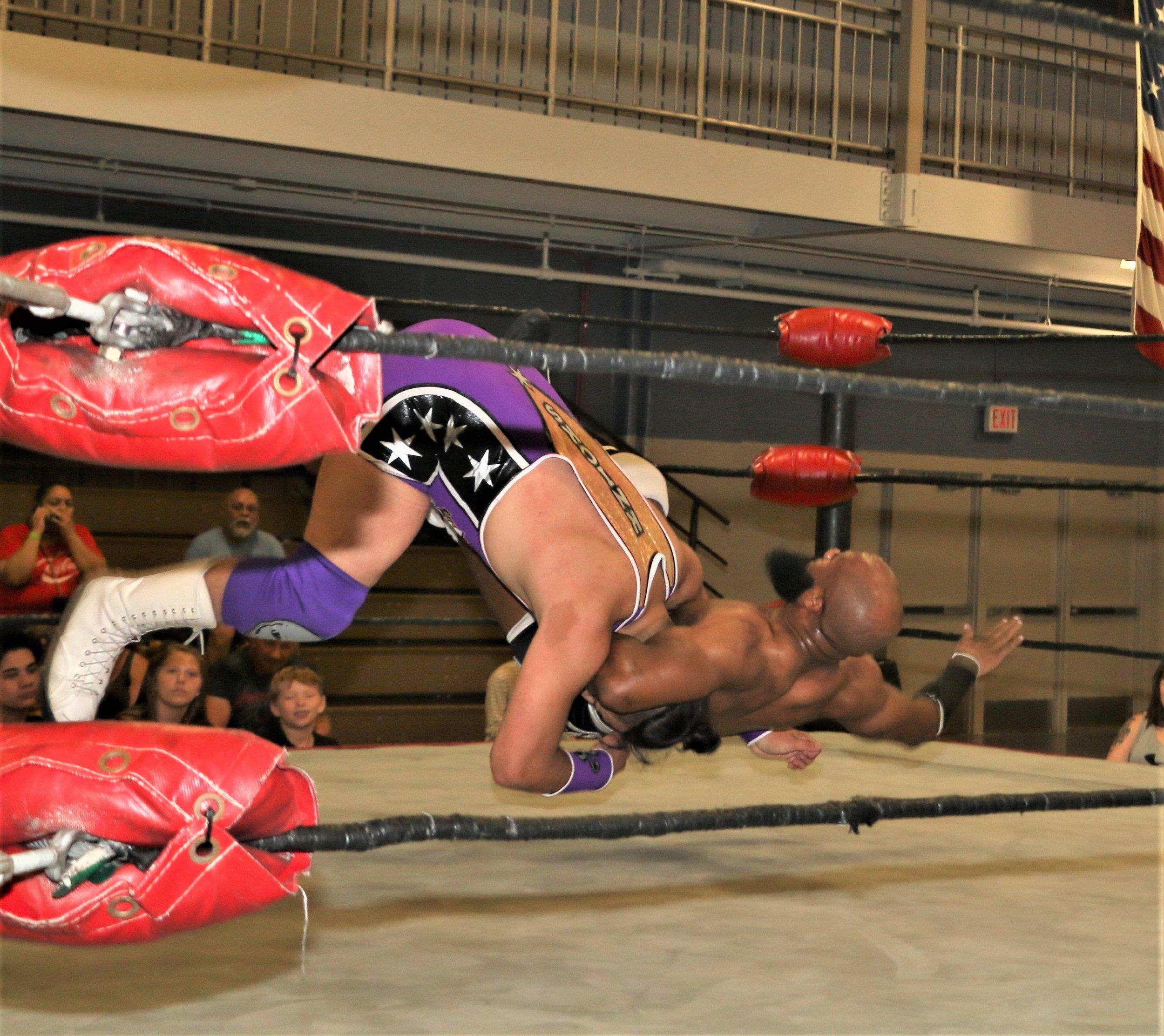 Bryce Benjamin delivers a DDT on Matt Knicks.