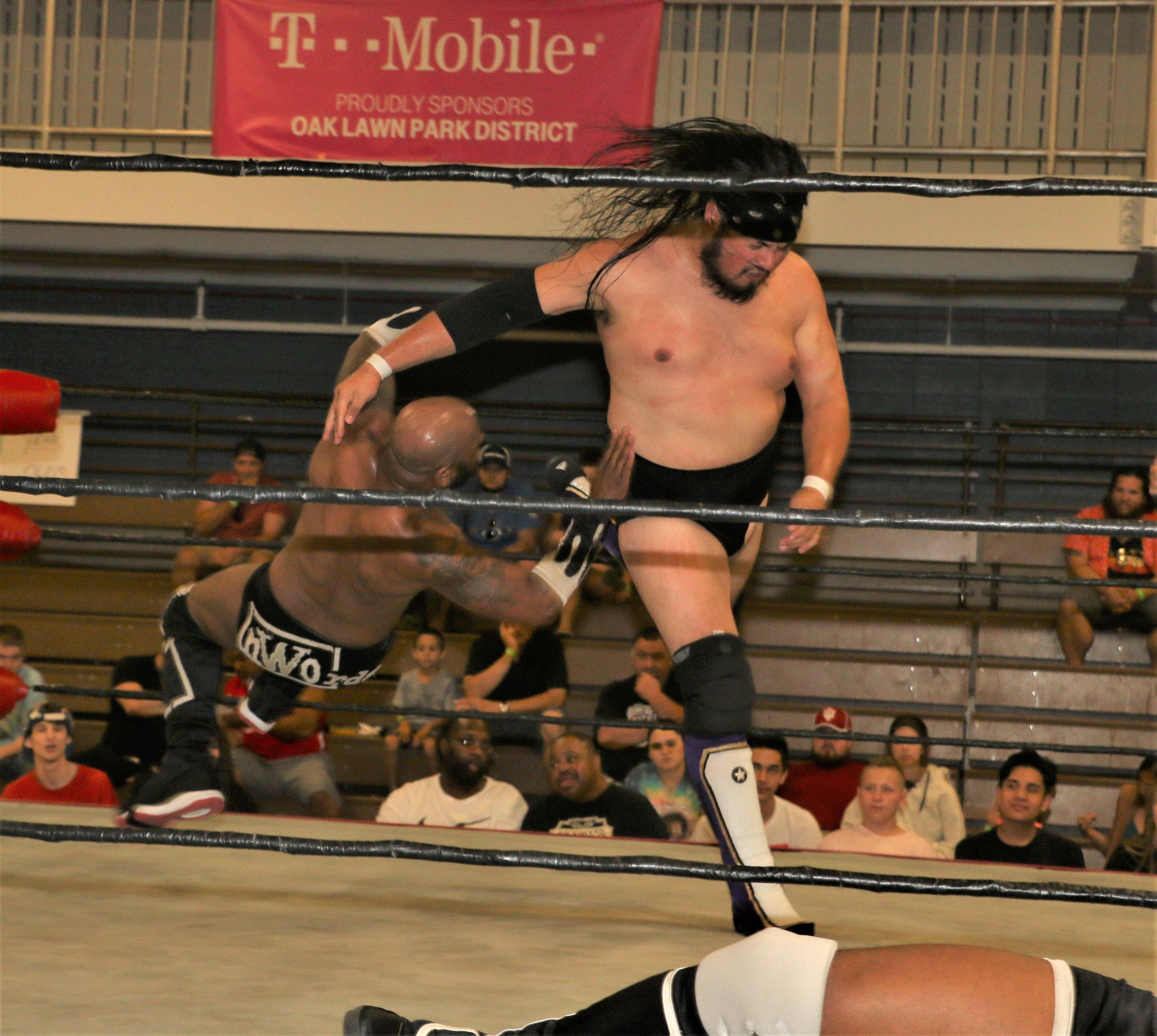 Chris Castro clotheslines Acid Jaz during the tag-team match.