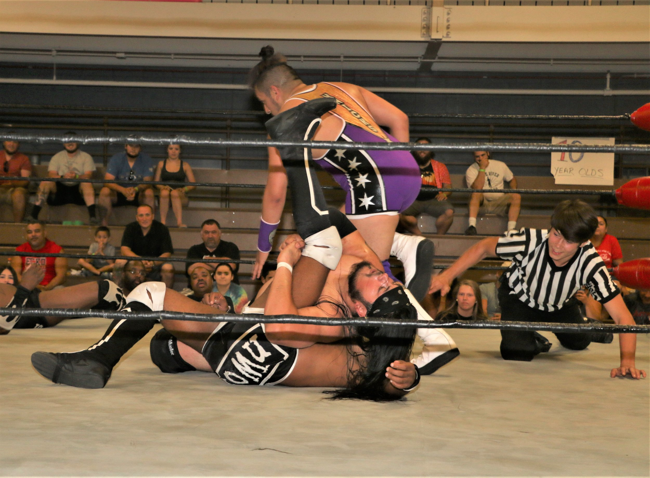 Chris Castro records the pinfall for the victory in the tag-team match.