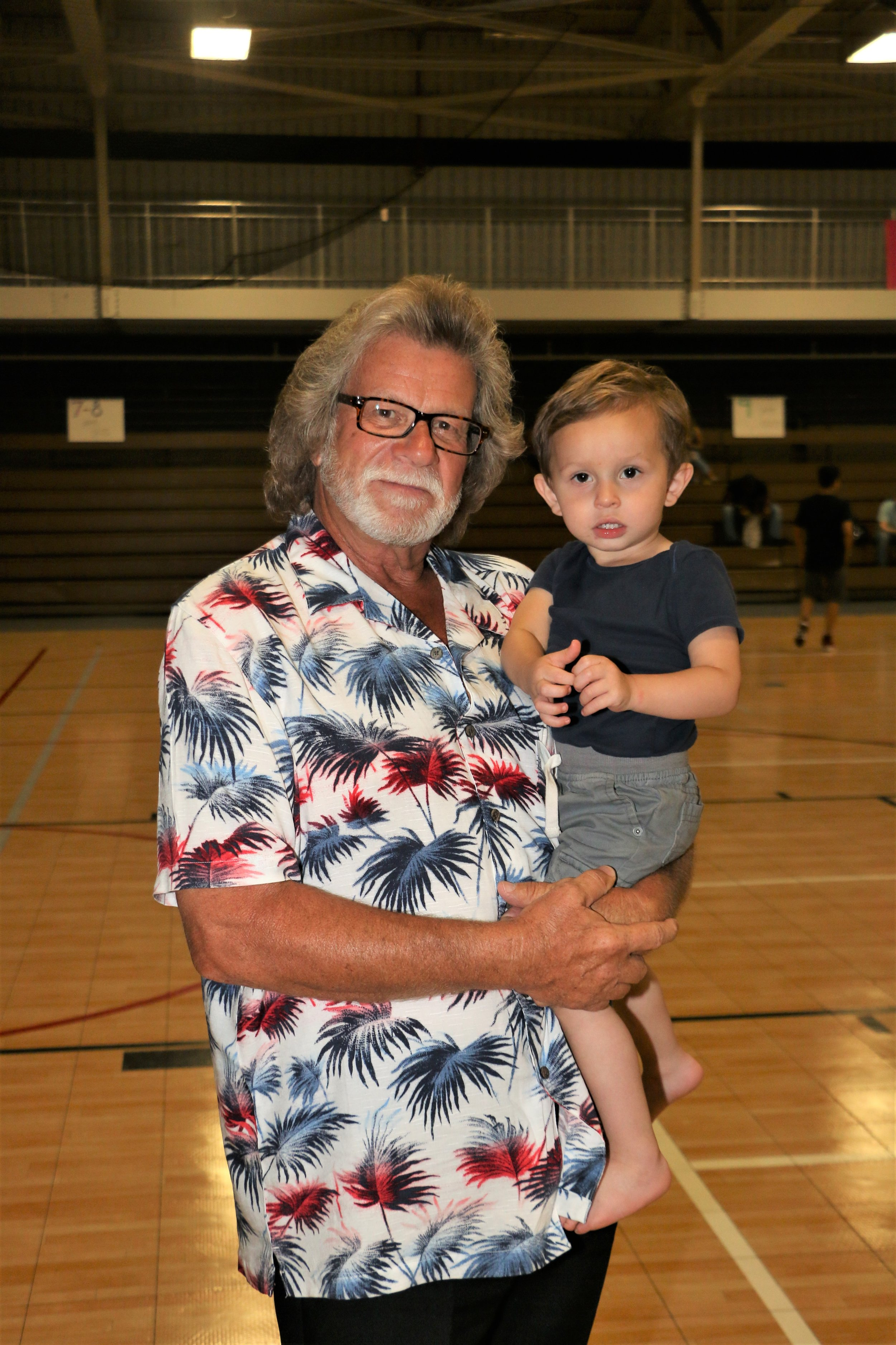 Mr. Ricolo with his grandson, Ricky, the son of Ruff Crossing and Melanie Cruise, during intermission.