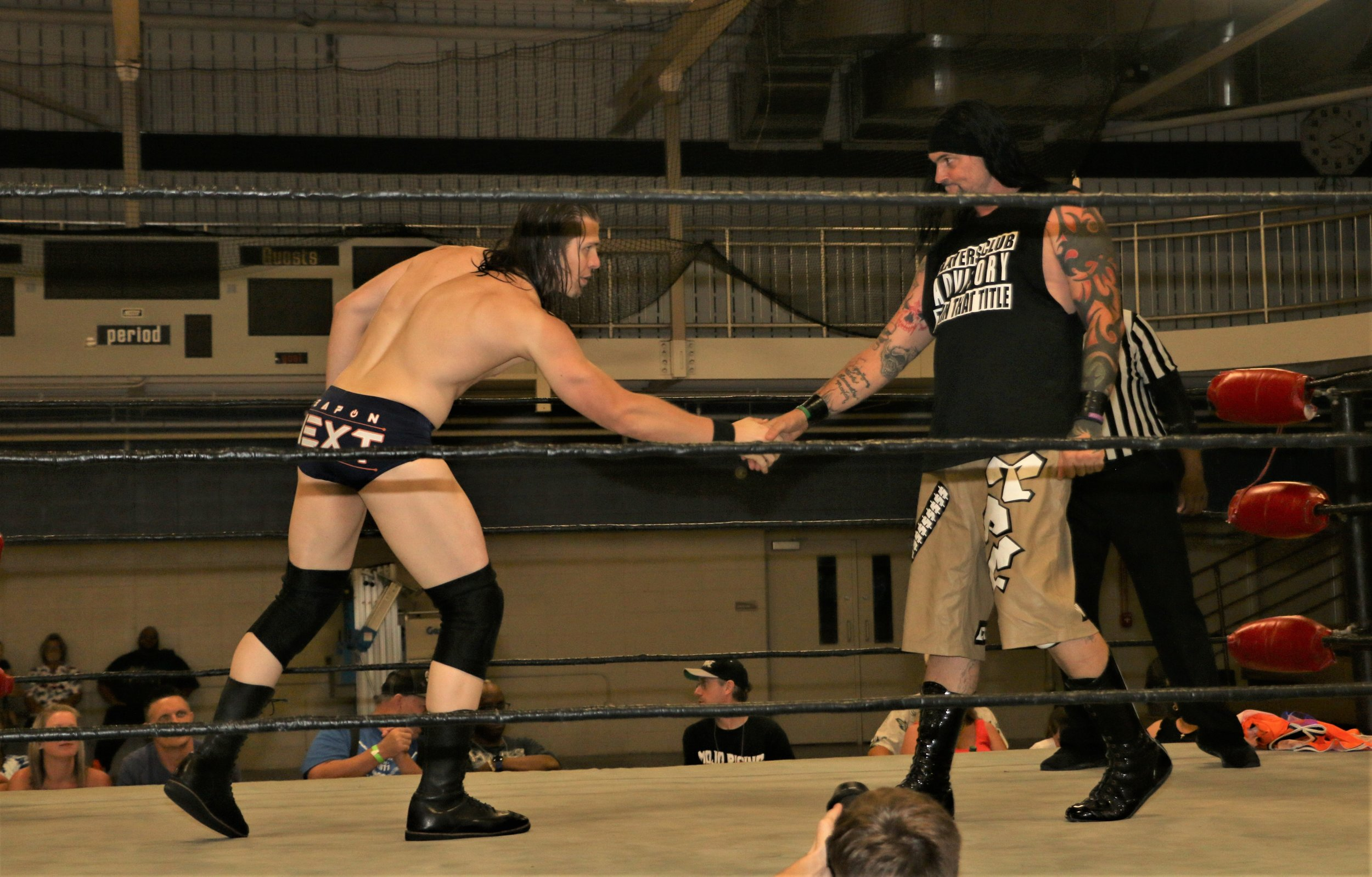 Frontline Pro Champion Logan Lynch, left, shakes hands with J Ca$h before the match.