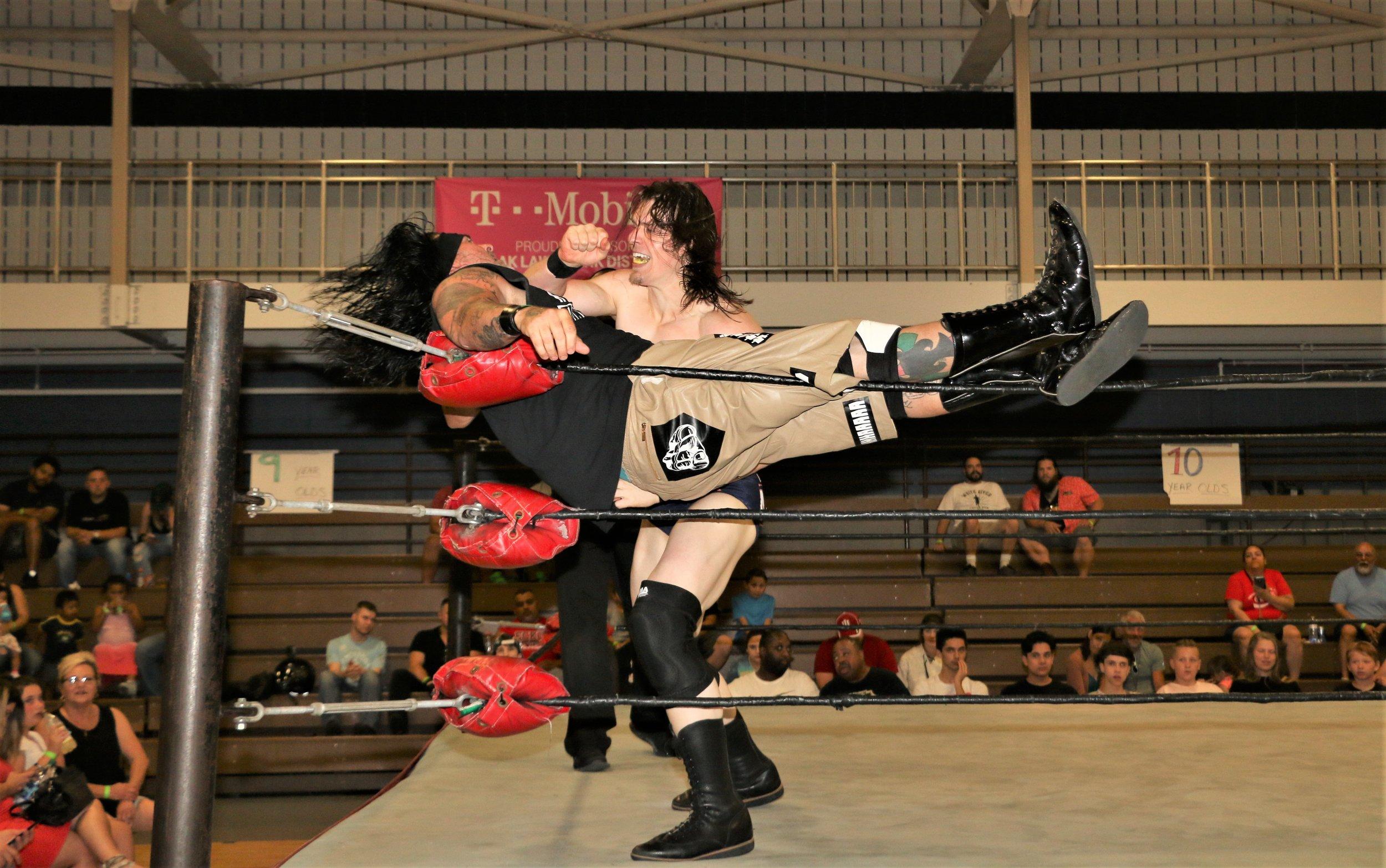 Logan Lynch attacks J Ca$h in the corner.