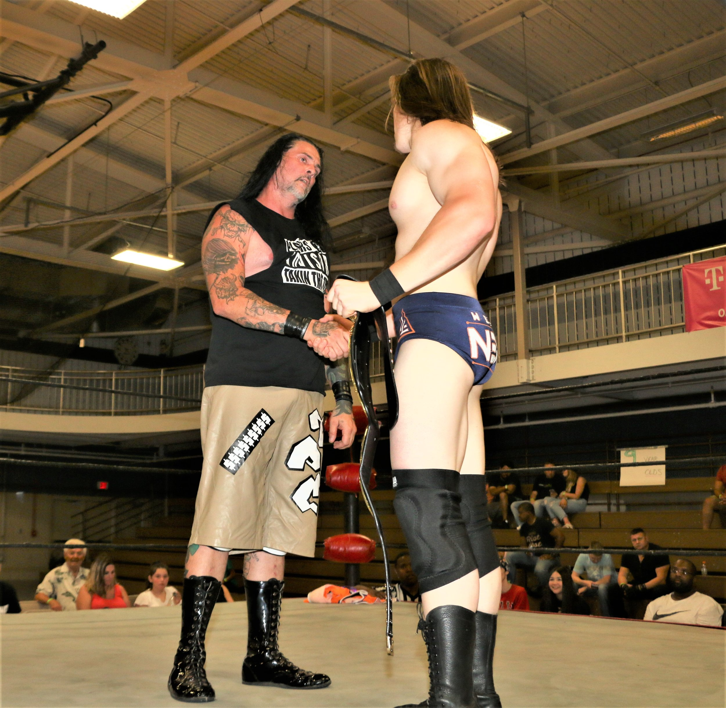 J Ca$h shakes the hand of Frontline Pro Champion Logan Lynch after the match.