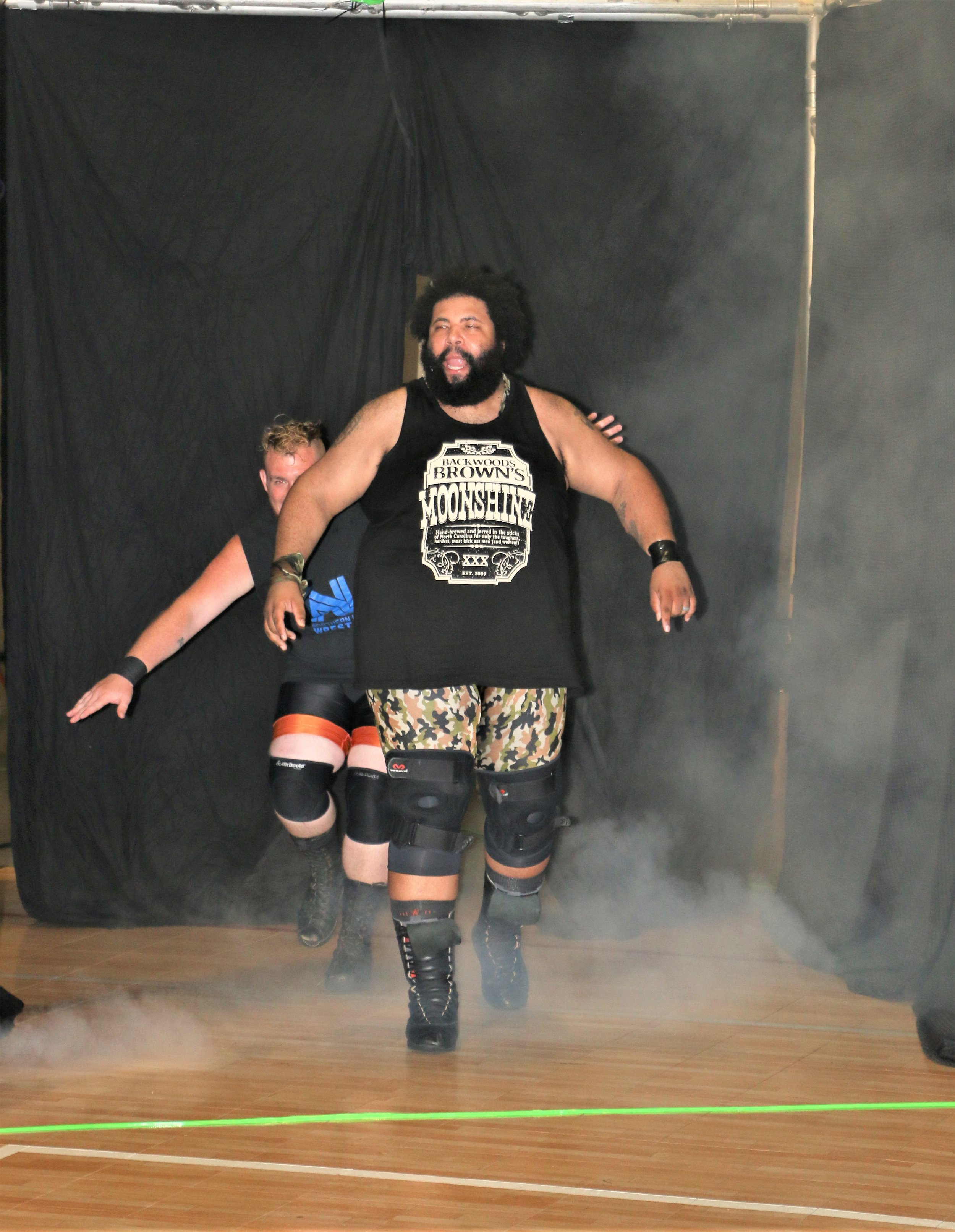 Backwoods Brown leads his team into the arena before the 10-man elimination tag-team match.