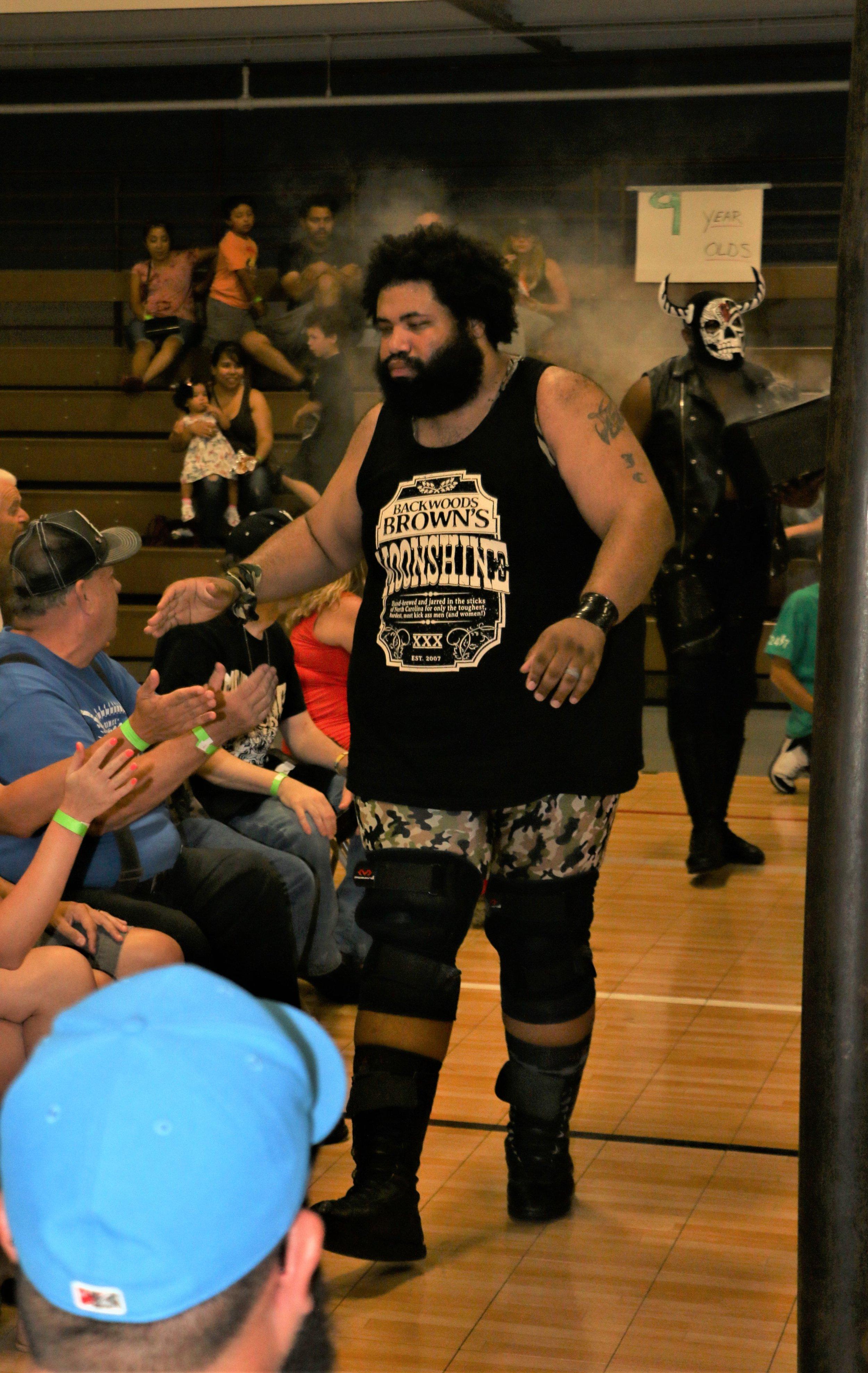 Backwoods Brown greets fans at ringside.