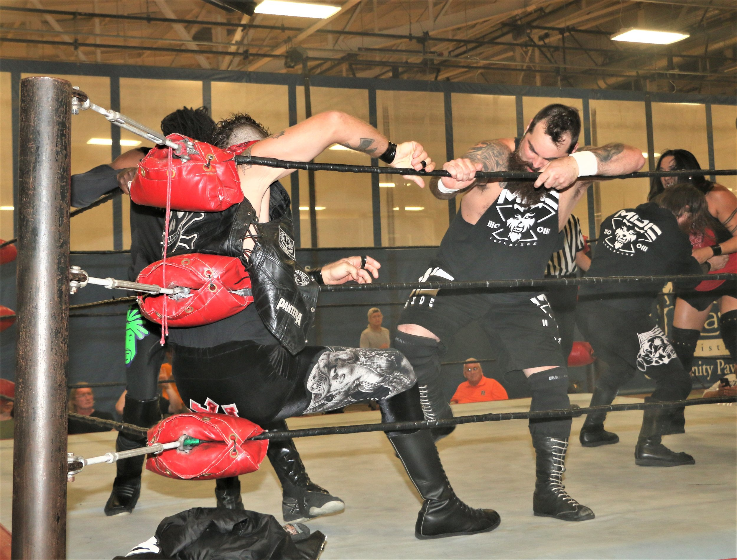 Nick Colucci, right, kicks Ruff Crossing in the corner during the 10-man elimination tag-team match.