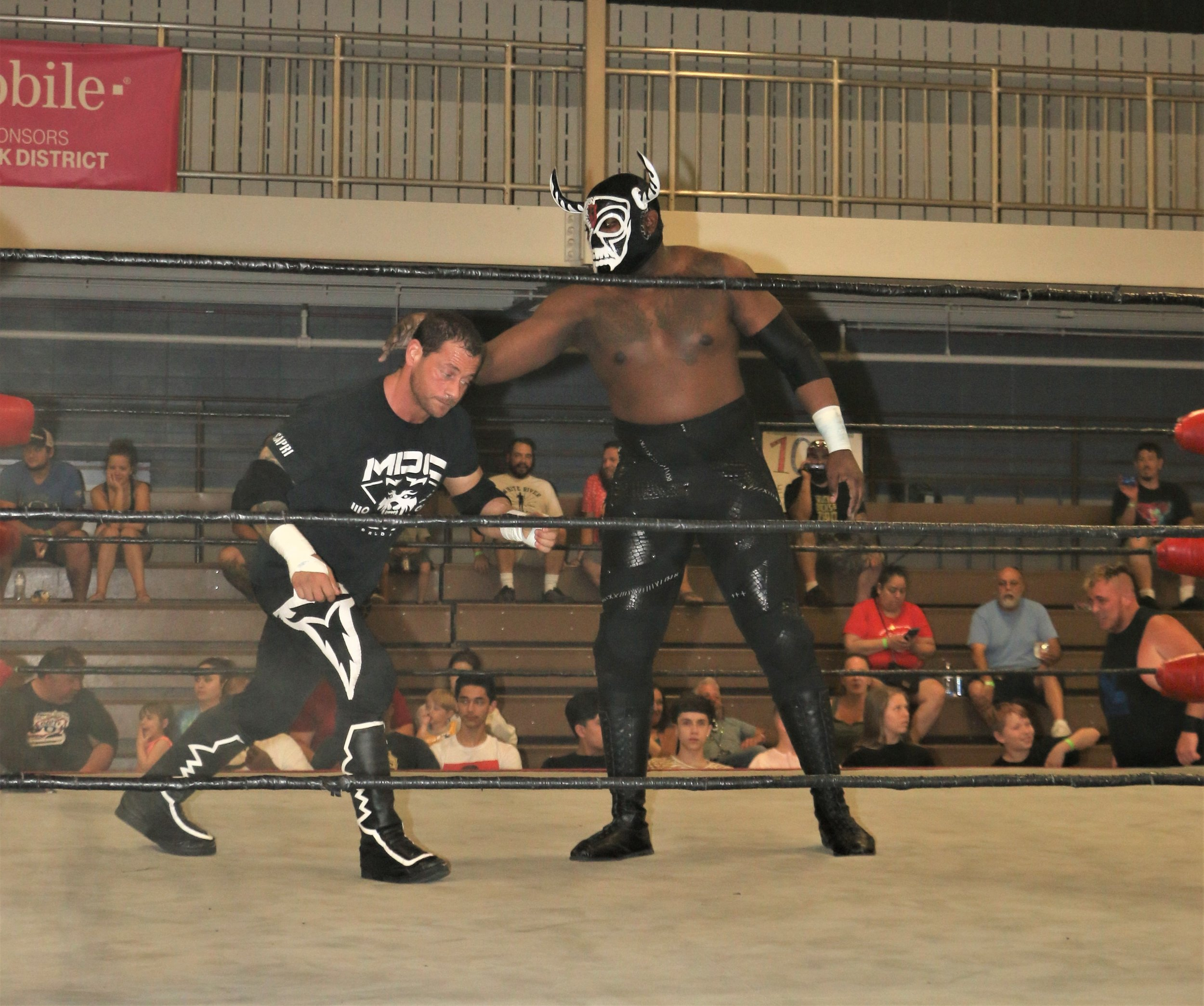 Mojo McQueen grabs Vic Capri during the 10-man elimination tag-team match.