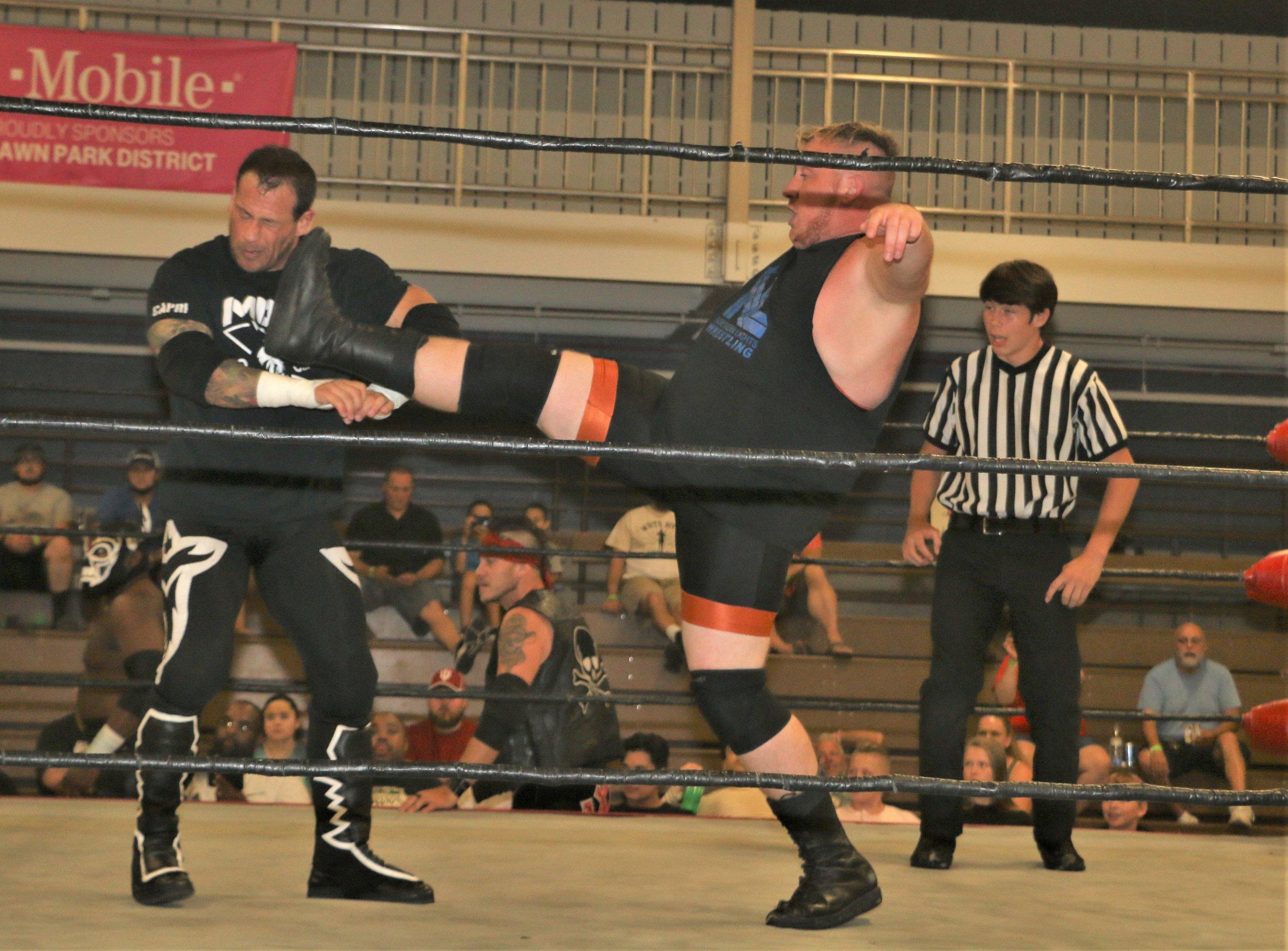 E.J. Jensen kicks Vic Capri.