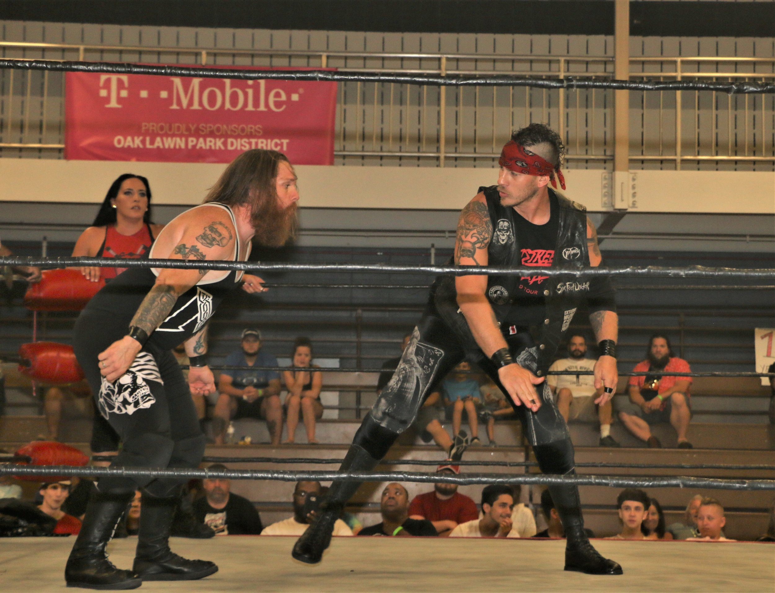 Ruff Crossing prepares to chop Ben McCoy during the 10-man elimination tag-team match.