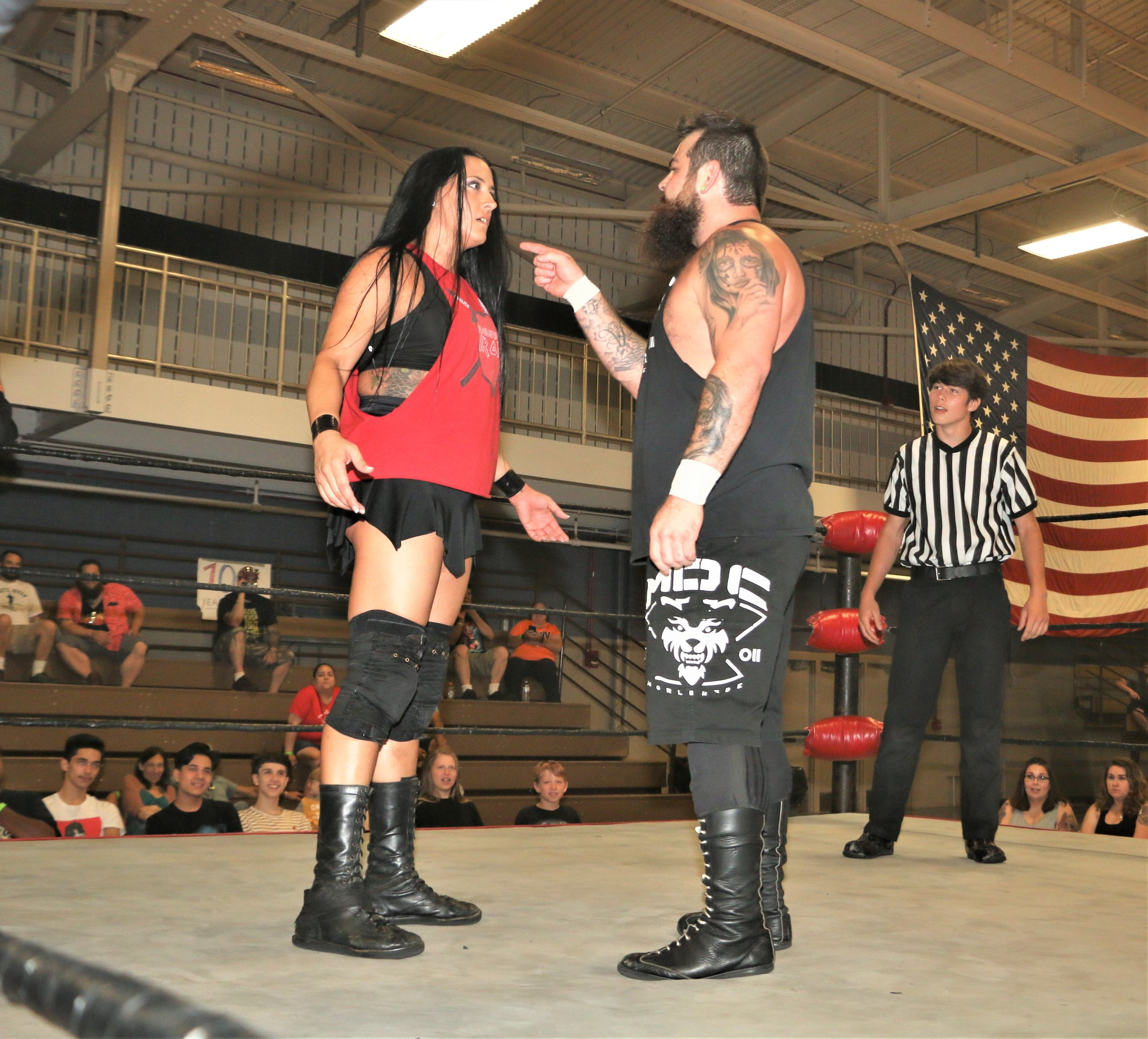 Nick Colucci taunts Melanie Cruise during the 10-man elimination tag-team match.