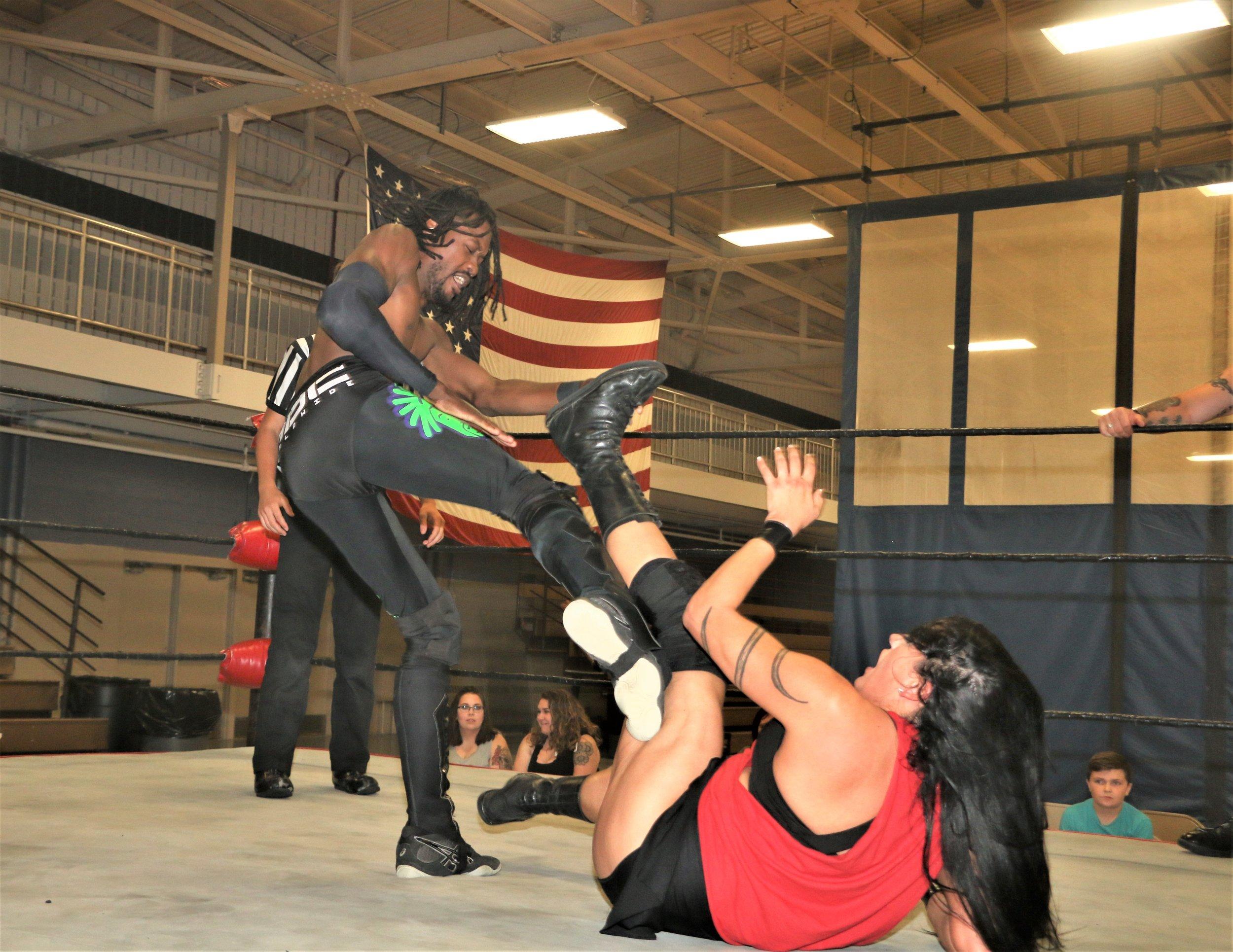TW3 kicks the quad of Melanie Cruise.