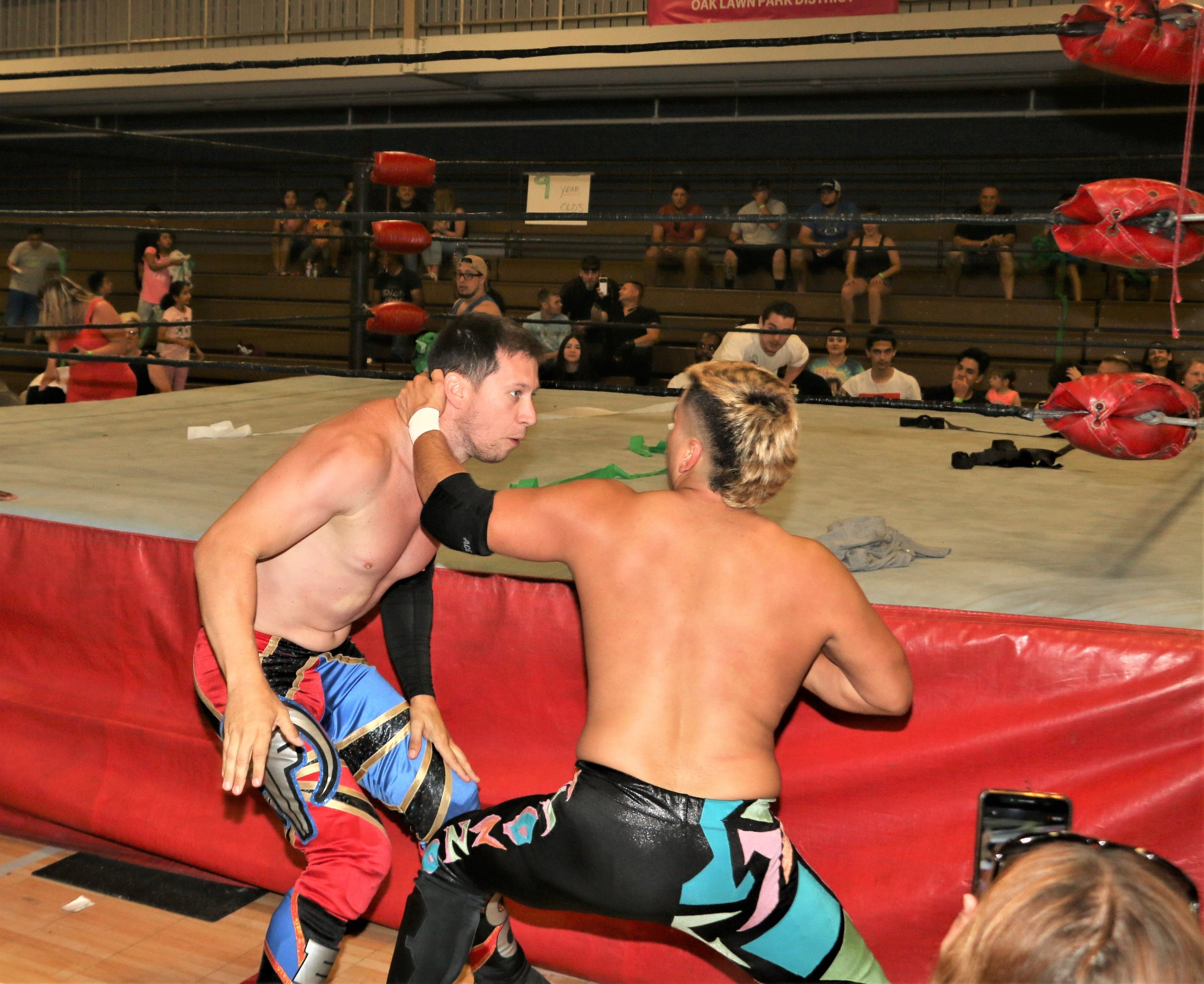 """Robert """"Ego"""" Anthony, left, and Joe Alonzo battle on the outside of the ring."""