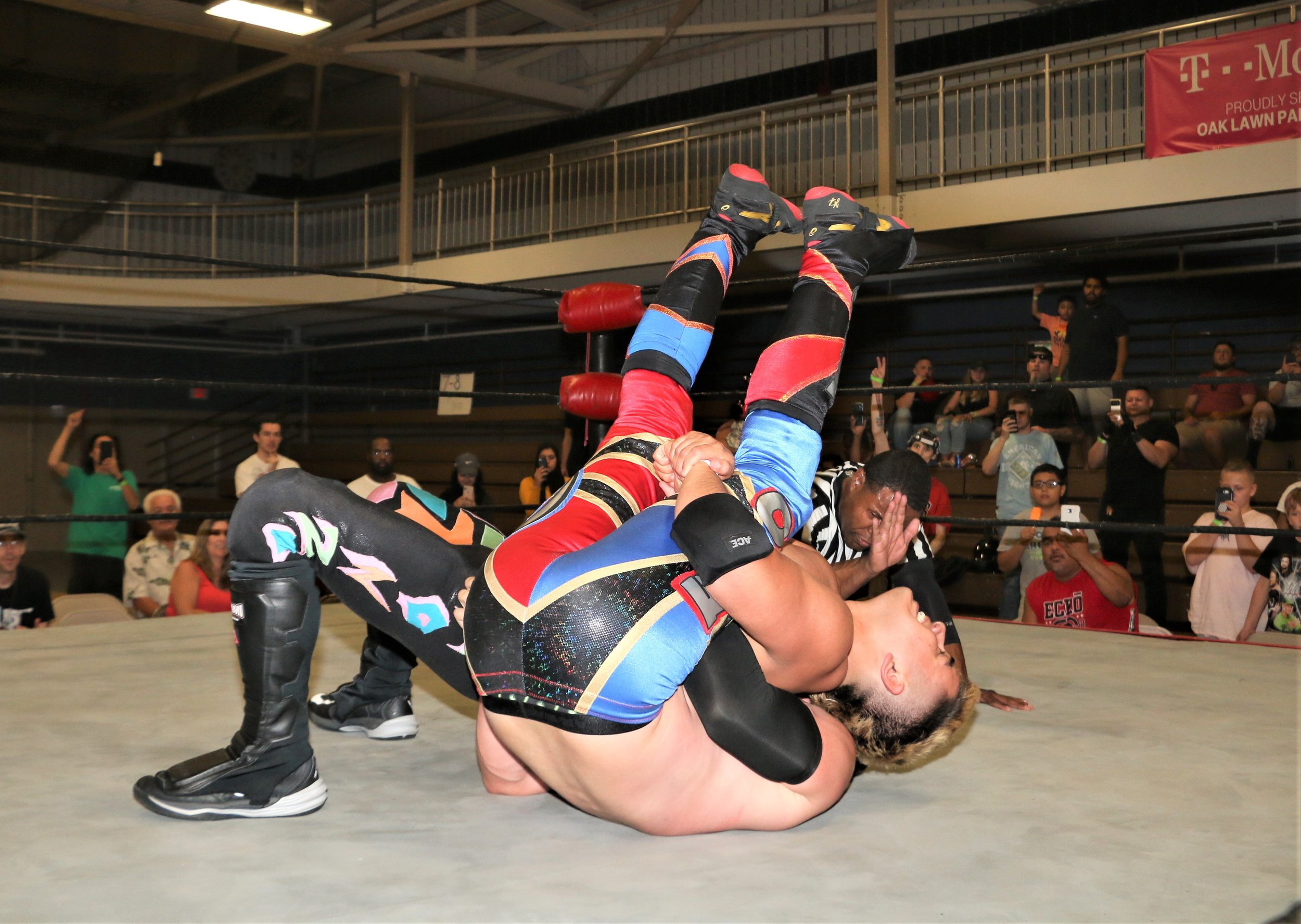 """Oak Lawn's Joe Alonzo secures the pin on Robert """"Ego"""" Anthony in the main event."""