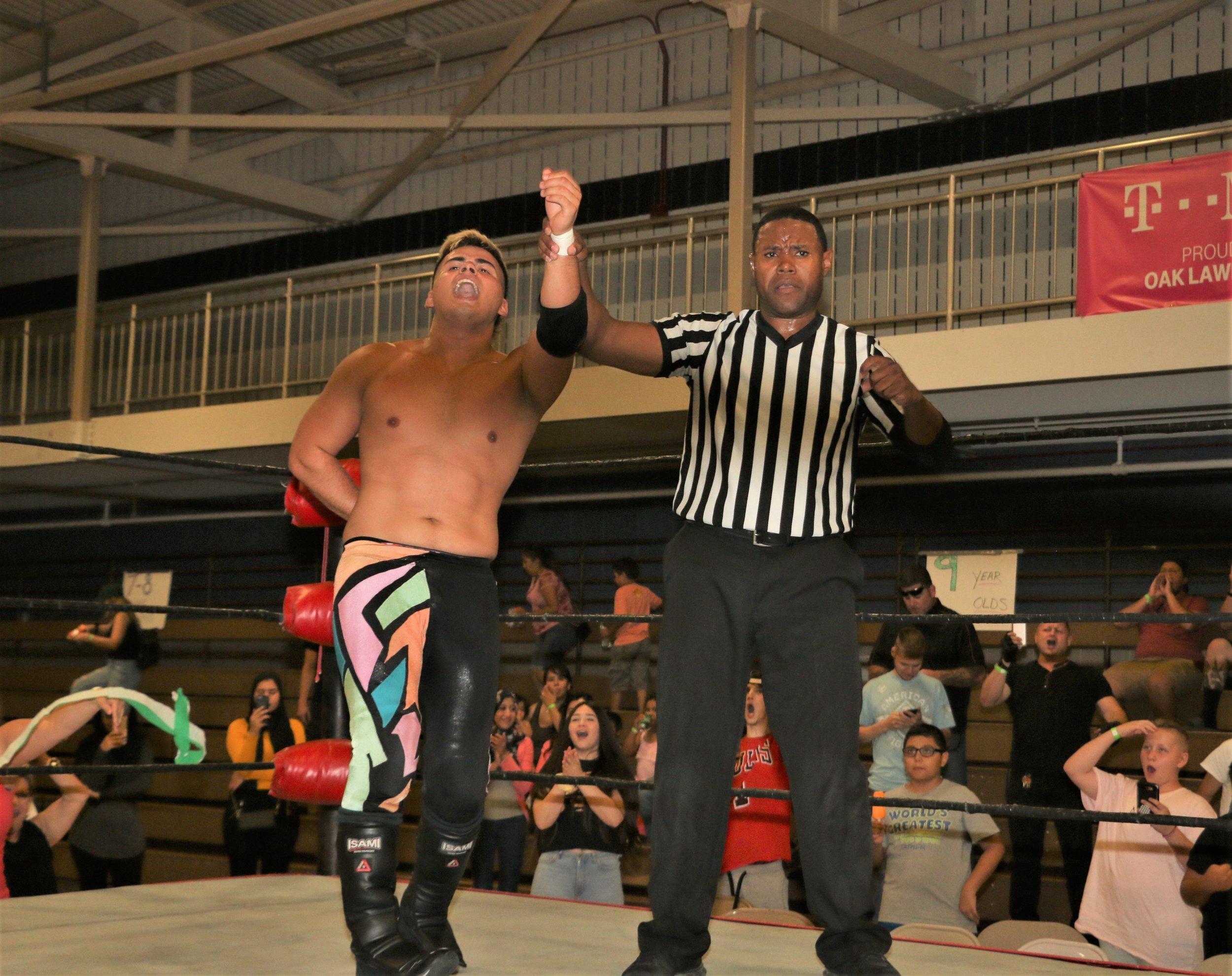 Referee Jessie Bush raises the hand of Joe Alonzo.